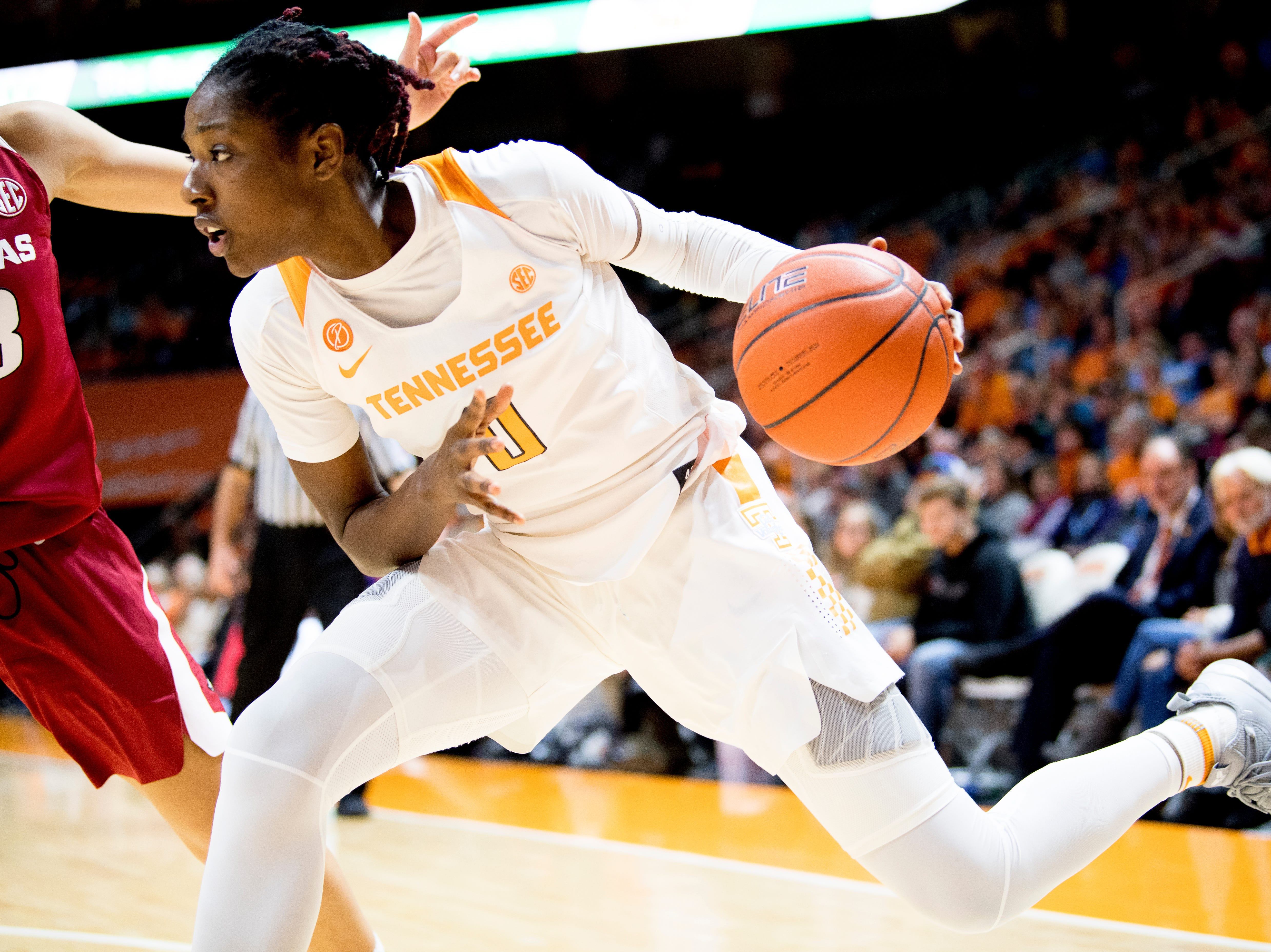 Tennessee guard/forward Rennia Davis (0) dribbles the ball during a game between Tennessee and Arkansas at Thompson-Boling Arena in Knoxville, Tennessee on Monday, January 21, 2019.
