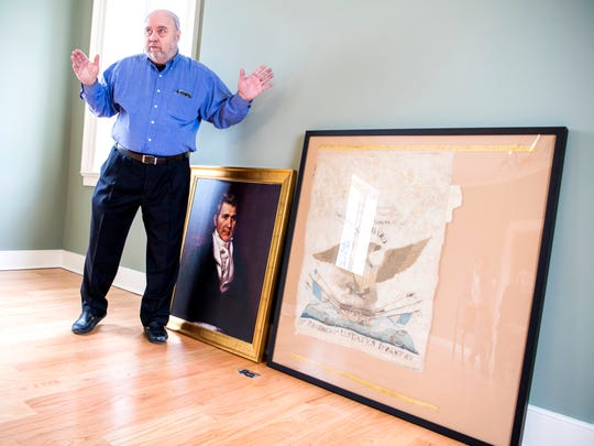Alex Brandau stands next to a portrait of John Williams and a flag of the 39th Infantry Regiment on Jan. 16, 2019, at the Col. John Williams House in Knoxville. Williams raised and commanded the 39th, the core of Andrew Jackson's assault force at the 1814 Battle of Horseshoe Bend.