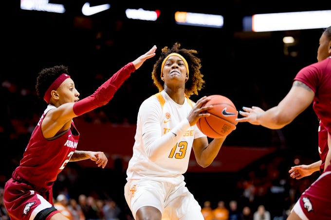 Tennessee guard Jazmine Massengill (13) attempts a shot past the Arkansas defense during a game at Thompson-Boling Arena in Knoxville, Tennessee on Monday, January 21, 2019.