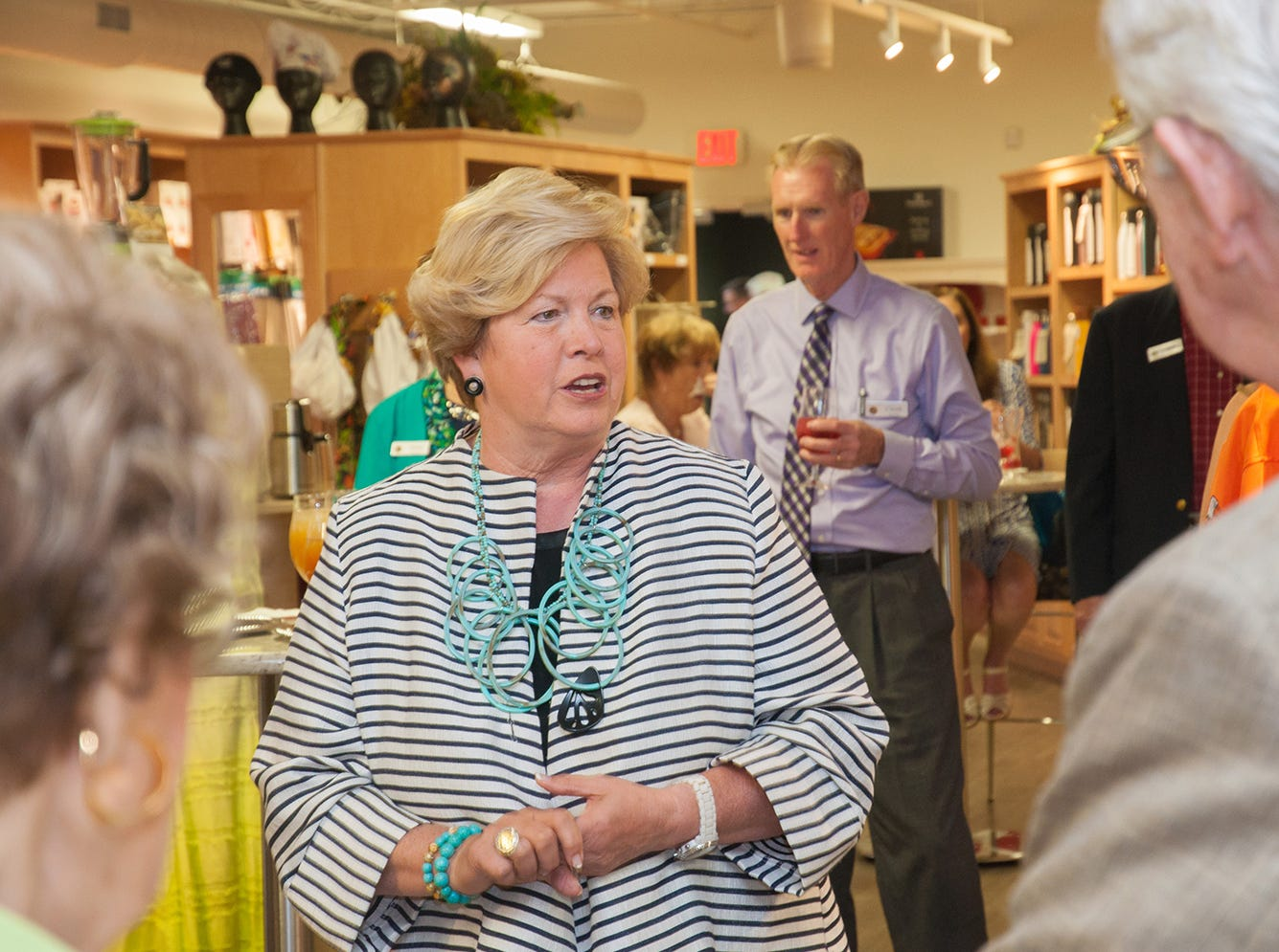 Joan Cronan speaks with guests gathered for Carson-Newman's Friendraiser event.