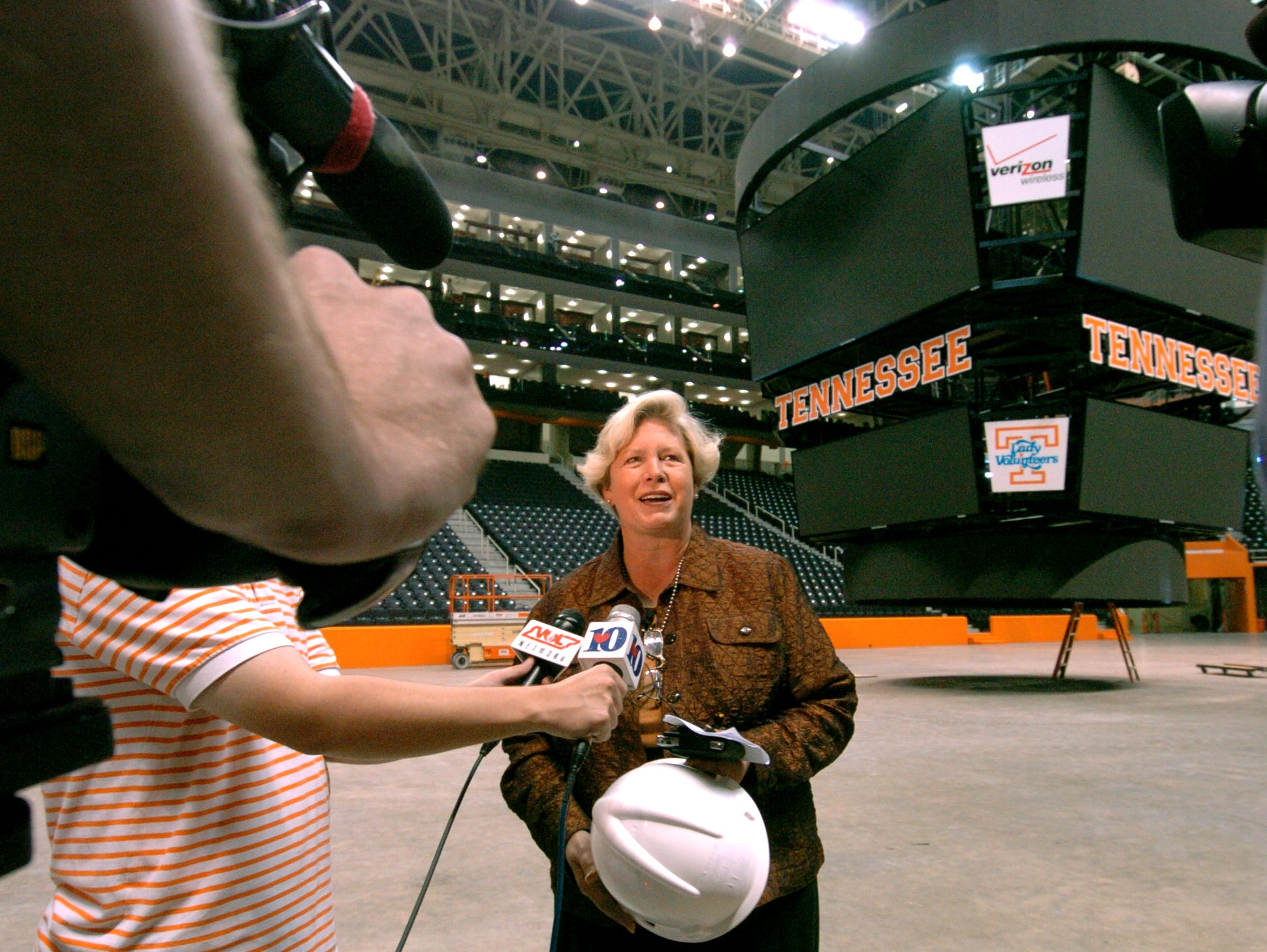 University of Tennessee Women's Athletics Director Joan Cronan prepares for an interview during a tour on Wednesday of the new Pratt Pavilion and remodeled Thompson-Boling Arena. A new $3 million scoreboard   and new luxury boxes are in the background.