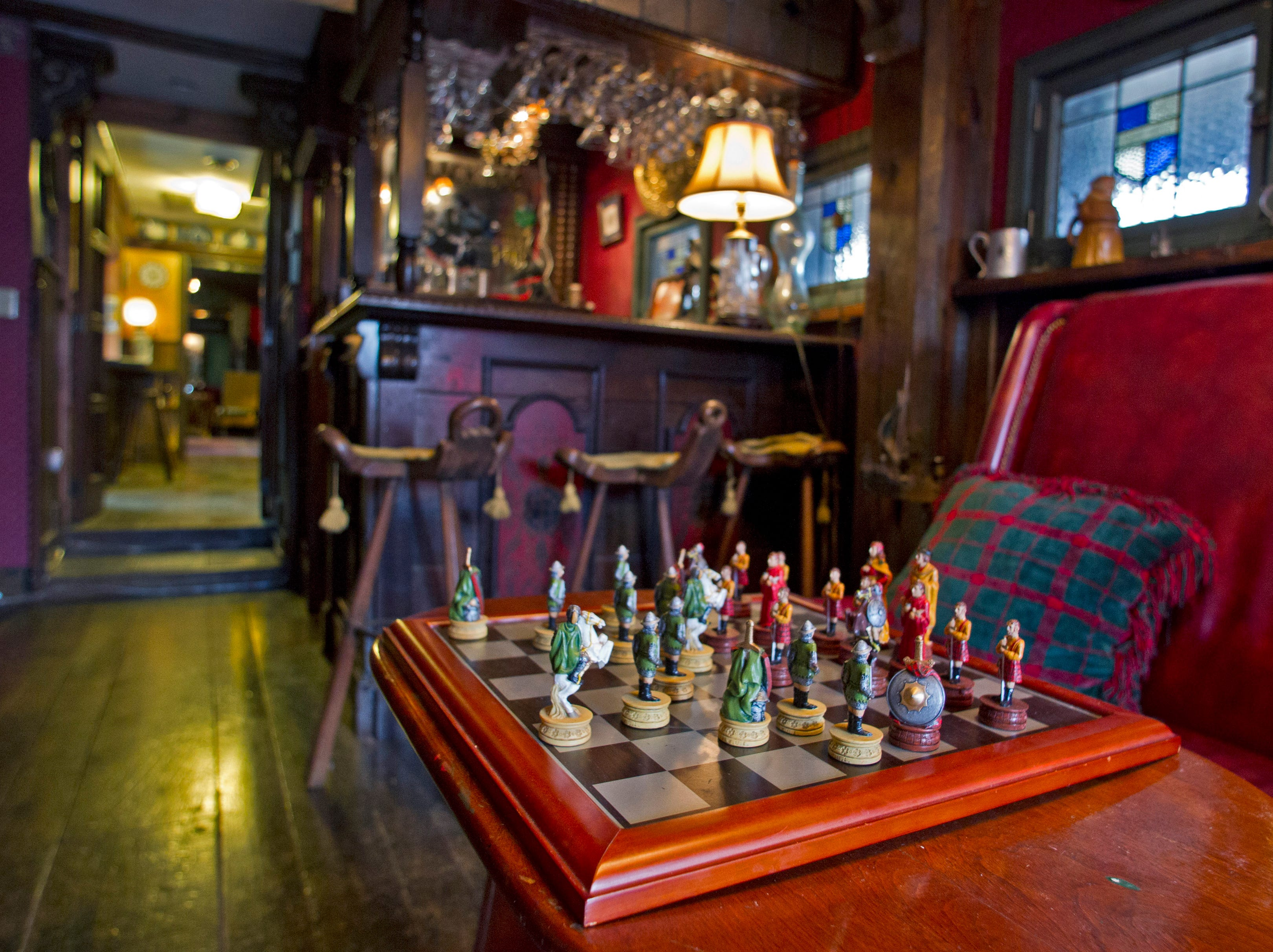 The Black Dog Pub at Williamswood is a cozy setting for a game of chess. The pub owes its name to a friendly Labrador pictured on the wall on March 15, 2015.