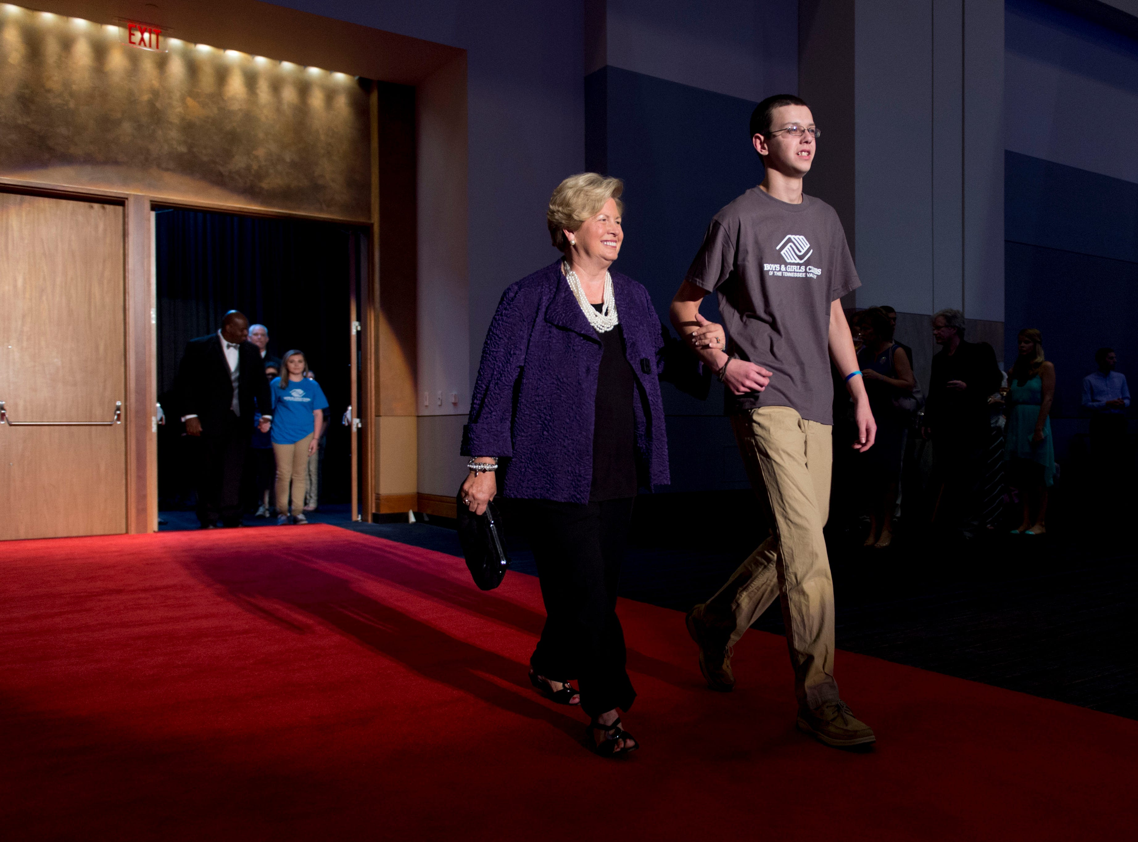 Joan Cronan is escorted into the ballroom during the Archie Greater Knoxville Sports Hall of Fame induction ceremony on Tuesday, August 4, 2015 at the Knoxville Convention Center.