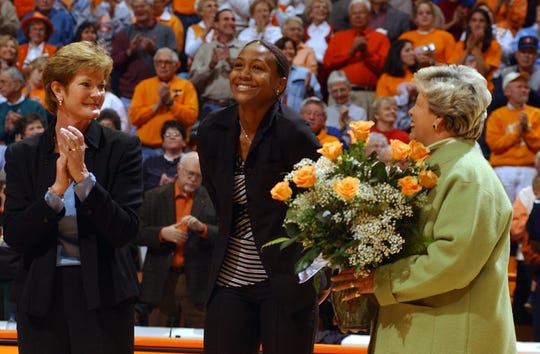 Flanked by Lady Vol coach Pat Summitt, left, and Joan Cronan, UT women's athletic director, right,  former Lady Vol Tamika Catchings had her jersey retired on Sunday during a halftime ceremony at Thompson-Boling Arena.