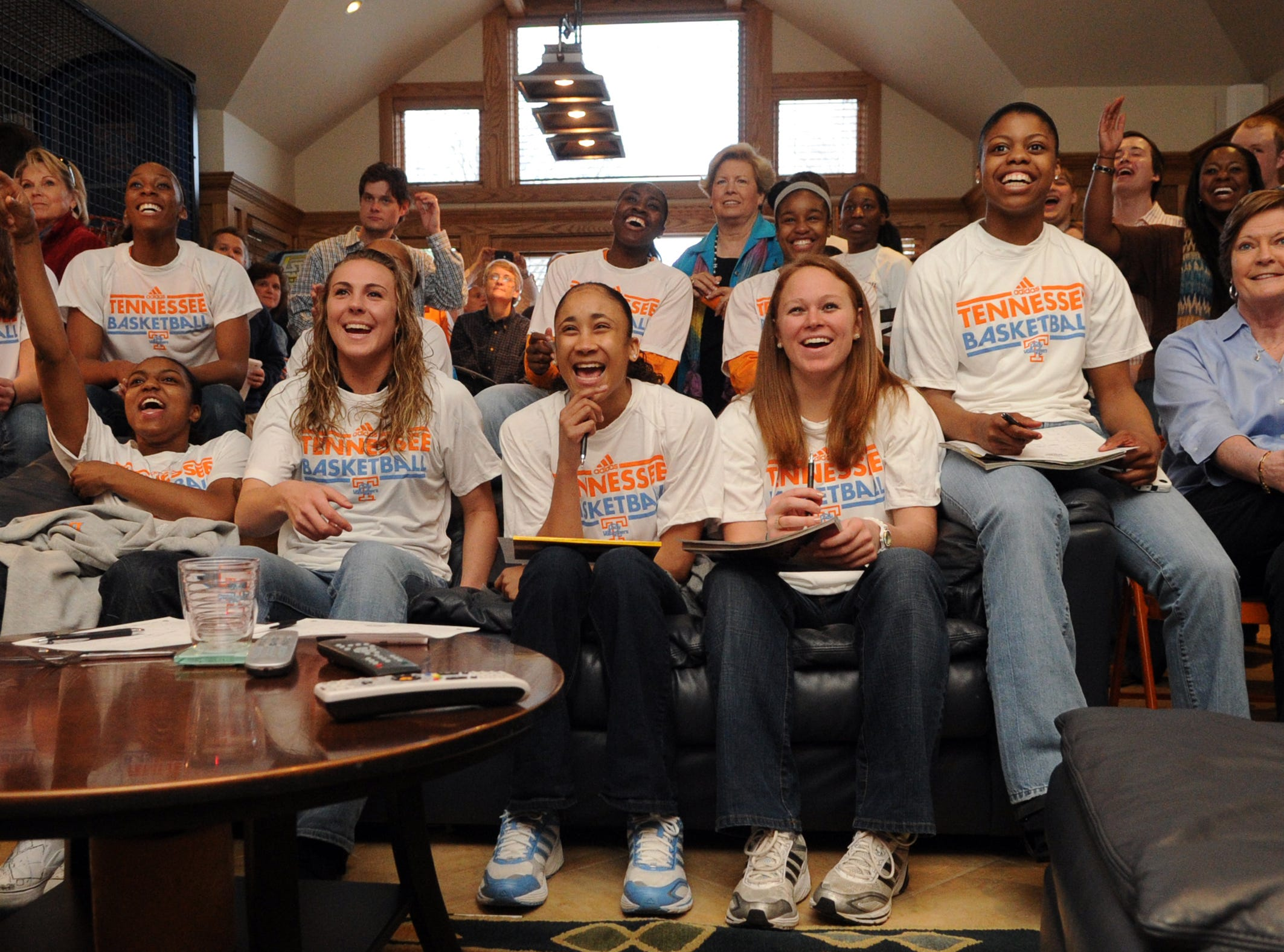 Members of the Lady Vols basketball team from left, Taber Spani, Glory Johnson, Kamiko Williams, Alicia Manning, Meighan Simmons, Shekinna Stricklen, University of Tennessee's women's athletic director Joan Cronan, Briana Bass, Sydney Smallbone, Lauren Avant, and head coach Pat Summitt watch highlights of themselves during the NCAA selection show viewing at Summitt's home on  Monday, March 14, 2011.