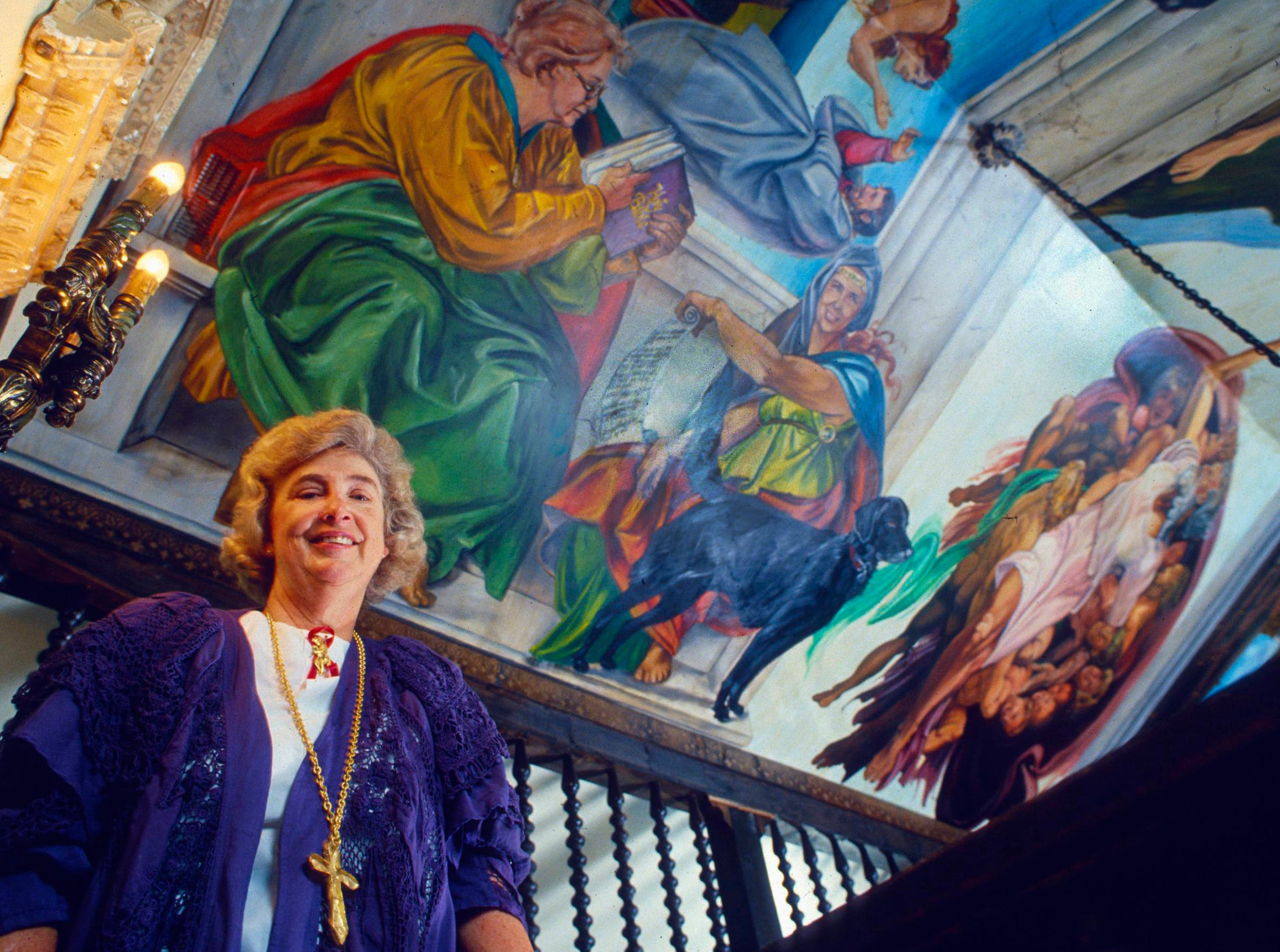 Julia Tucker shows a painted ceiling at Williamswood Castle June 16, 1994, in South Knoxville.