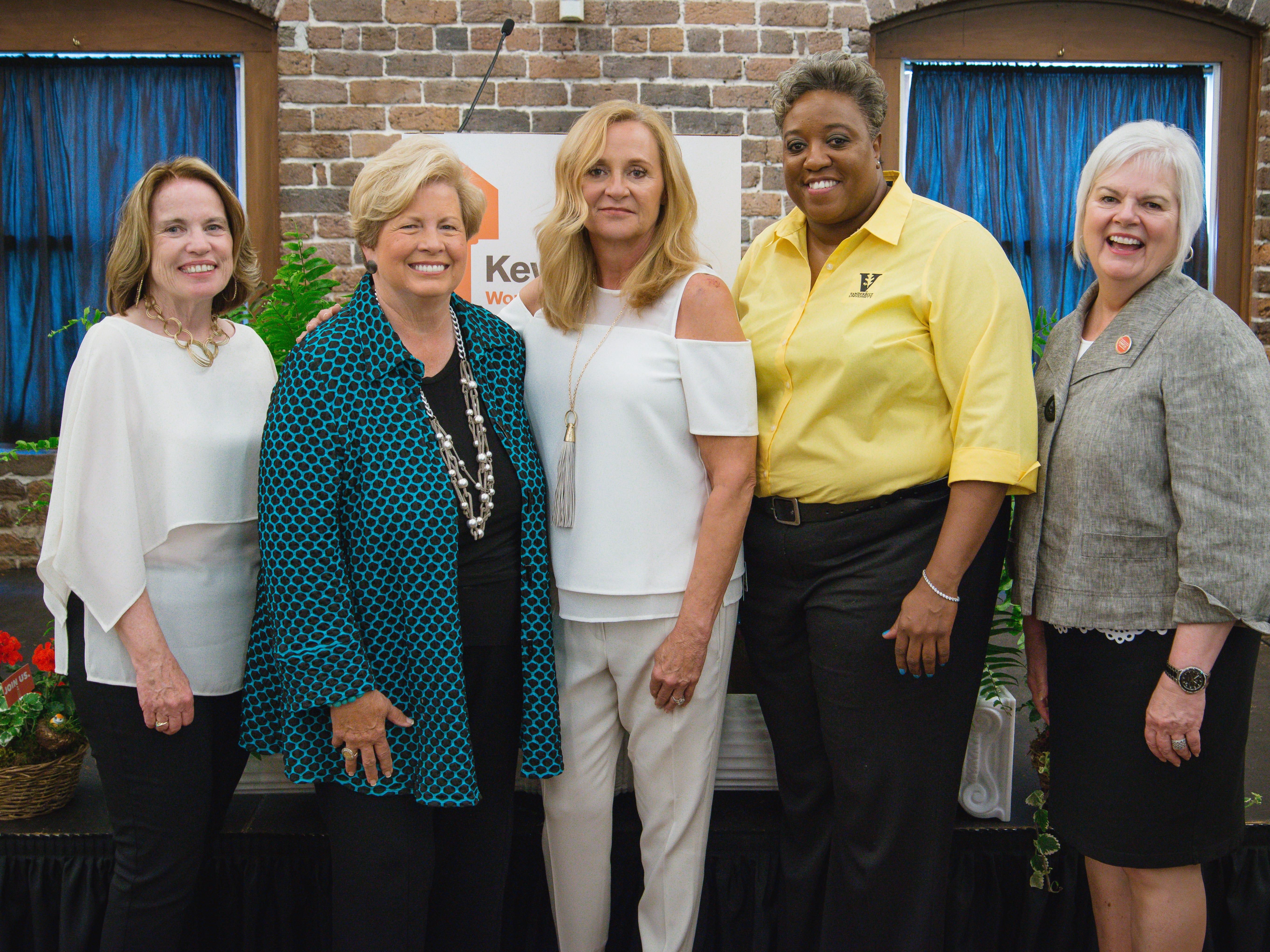 YWCA Knoxville CEO Marigail Mullin, Joan Cronan, Keys of Hope presenting sponsor Nancy Land, Meshia Thomas and YWCA Board of Directors President Debbie Stevens.