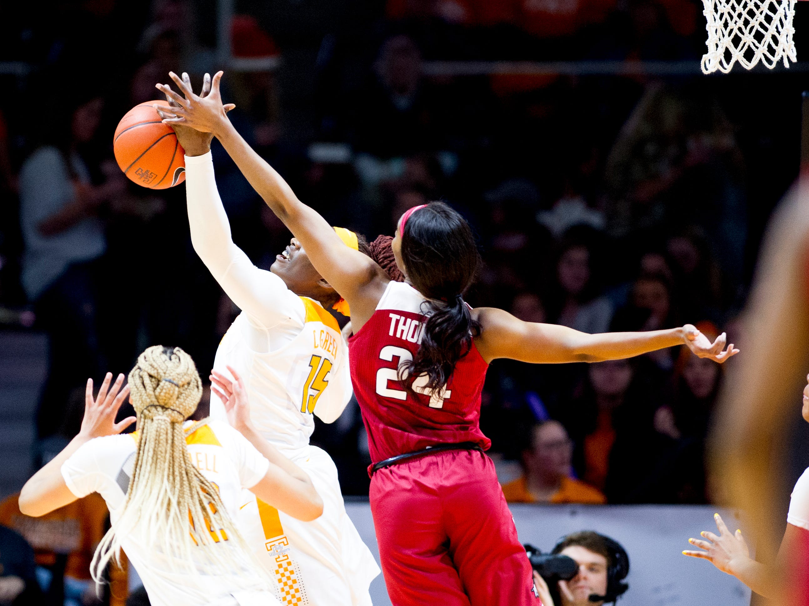 Tennessee forward Cheridene Green (15) grabs the rebound ball from Arkansas forward Taylah Thomas (24) during a game between Tennessee and Arkansas at Thompson-Boling Arena in , Tennessee on Monday, January 21, 2019.