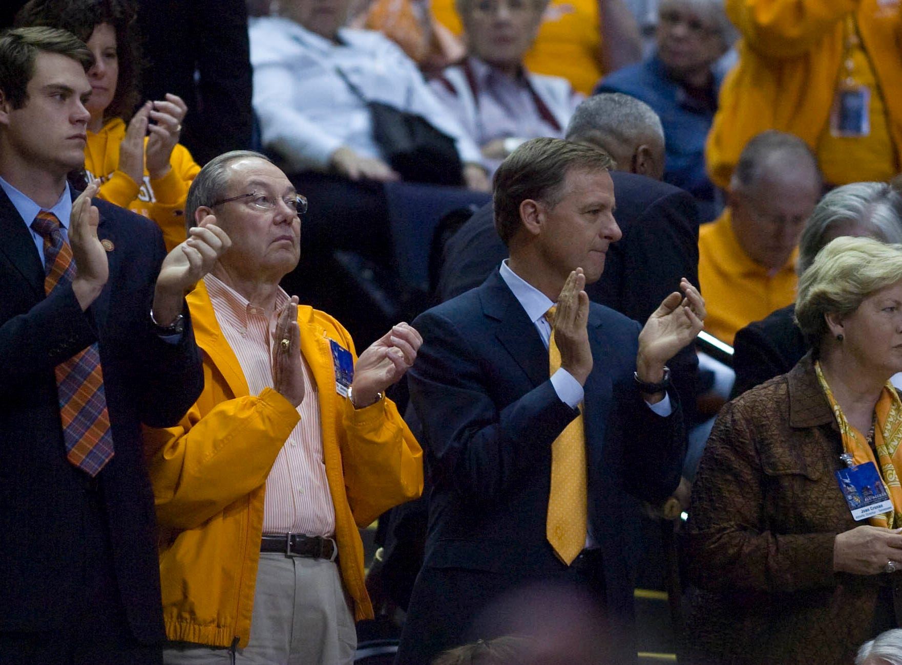 Tennessee governor Bill Haslam (second from right) sits with UT women's athletics director Joan Cronan (right) and UT Chancellor Jimmy Cheek as UT played Florida during the second round of SEC Tournament play in Nashville on Friday March 4, 2011. UT won the game 92-75.