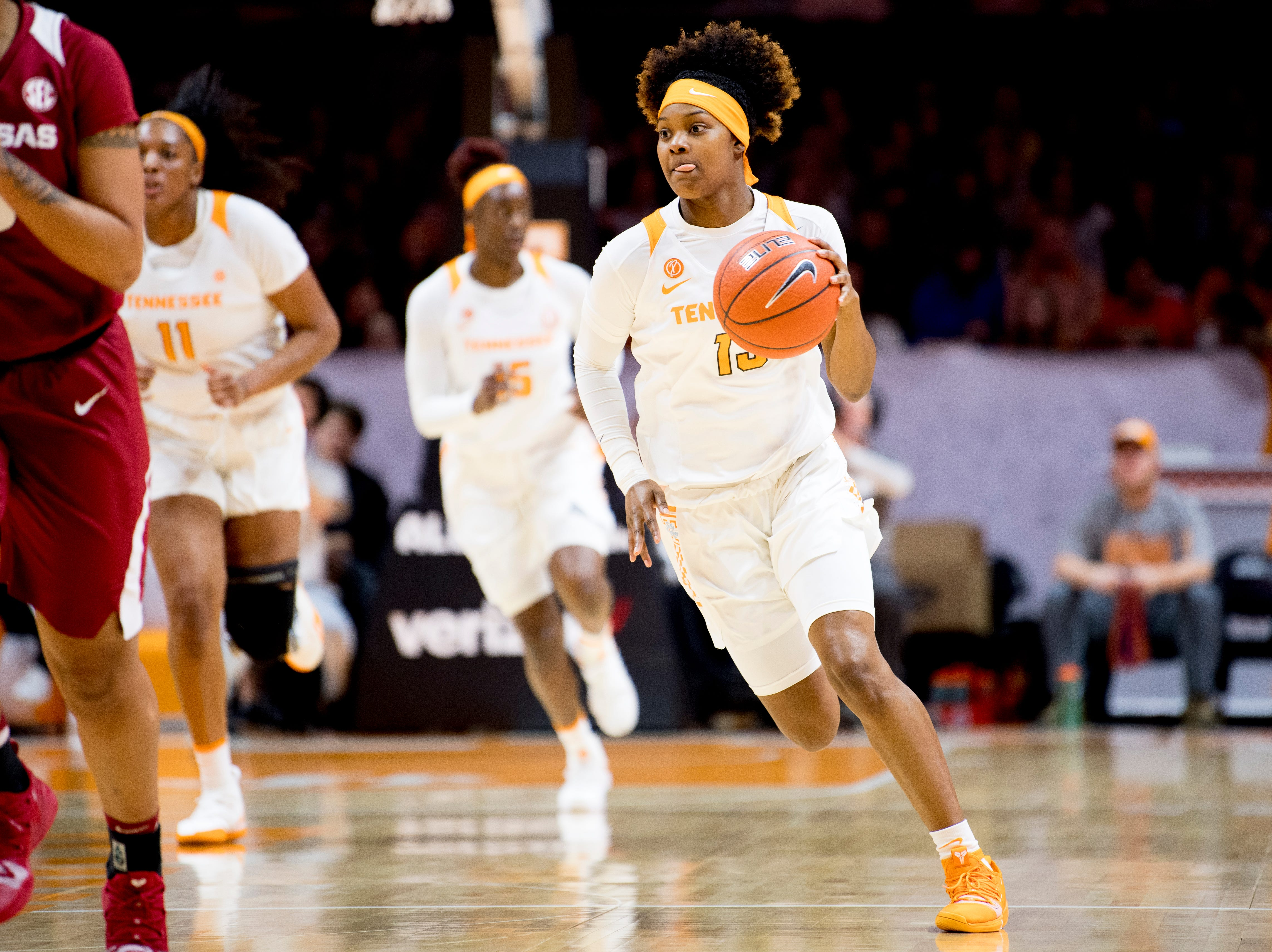 Tennessee guard Jazmine Massengill (13) dribbles down the court during a game between Tennessee and Arkansas at Thompson-Boling Arena in , Tennessee on Monday, January 21, 2019.