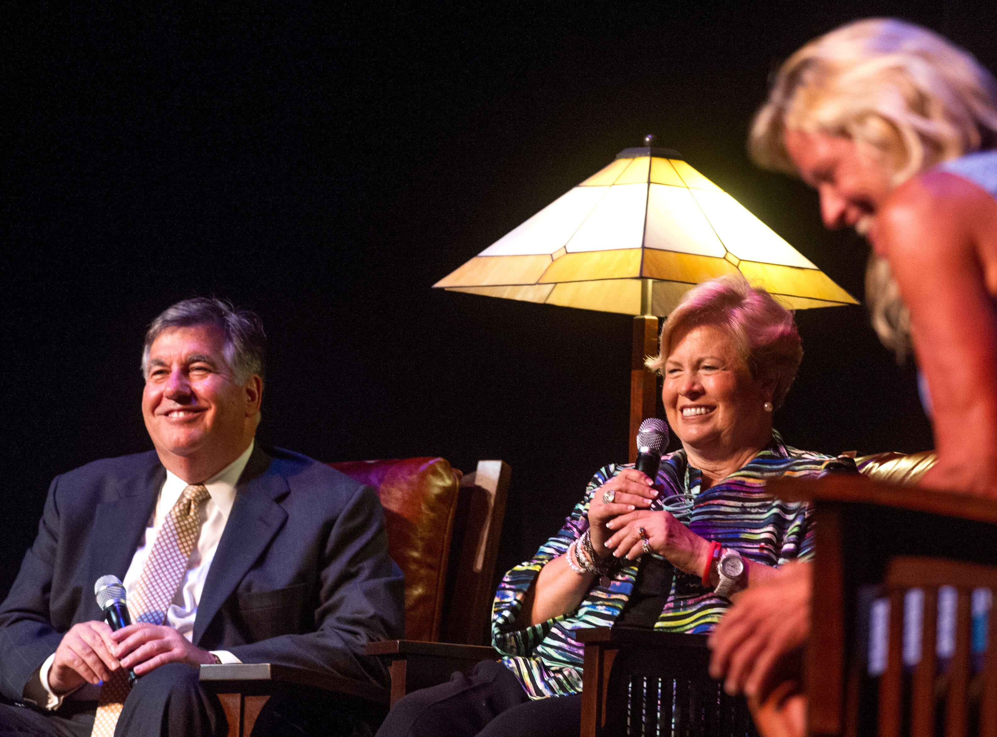 Director of Broadcasting at the University of Tennessee Bob Kesling (from left) and University of Tennessee women's athletic director emeritus Joan Cronan  share a laugh while reminiscing during An Evening of Champions, a celebration of Pat Summit and her career as a basketball coach benefitting both the St. Jude and Pat Summit Foundations, at the Tennessee Theater  Saturday, July 11, 2015.