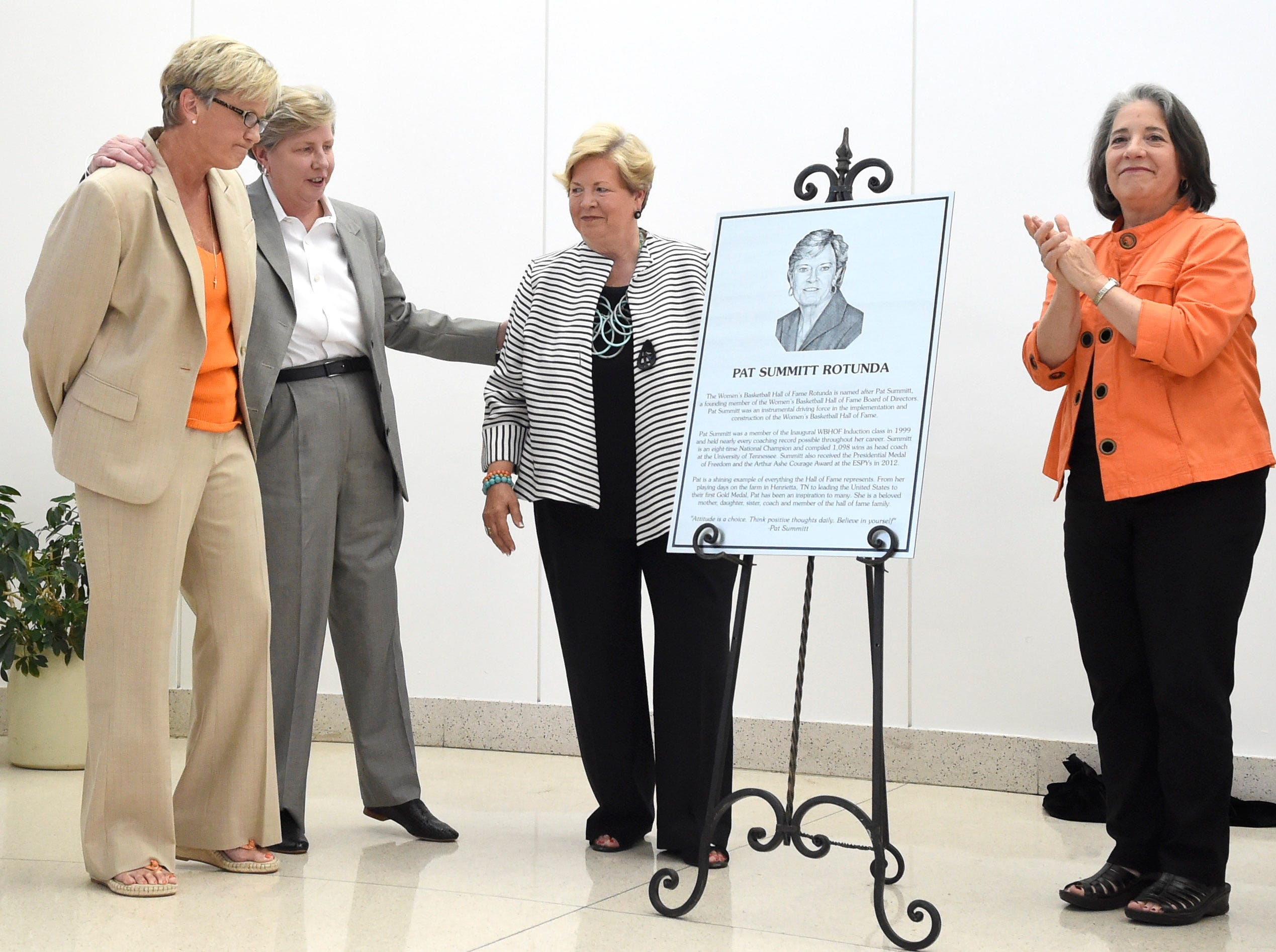 Tennessee women's basketball coach Holly Warlick, Women's Basketball Hall of Fame board president Sue Donohoe, and former Tennessee women's athletics director Joan Cronan, from left, look on as Knoxville city mayor Madeline Rogero, right, applauds after revealing a plaque honoring former Tennessee women's basketball coach Pat Summitt at the Women's Basketball Hall of Fame on Friday, June 12, 2015. The Hall's South Rotunda was named in Summitt's honor.