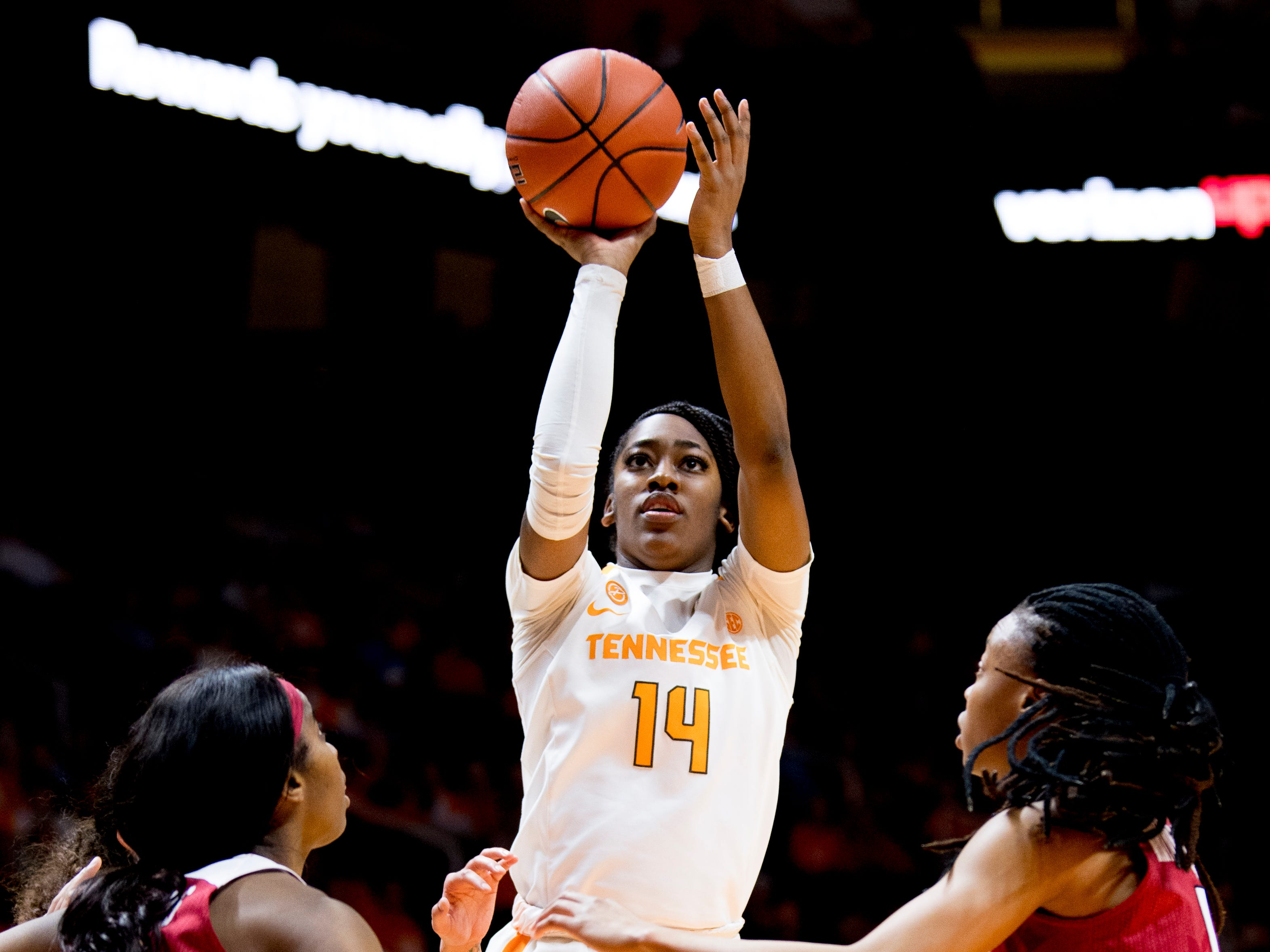 Tennessee guard Zaay Green (14) shoots the ball during a game between Tennessee and Arkansas at Thompson-Boling Arena in Knoxville, Tennessee on Monday, January 21, 2019.