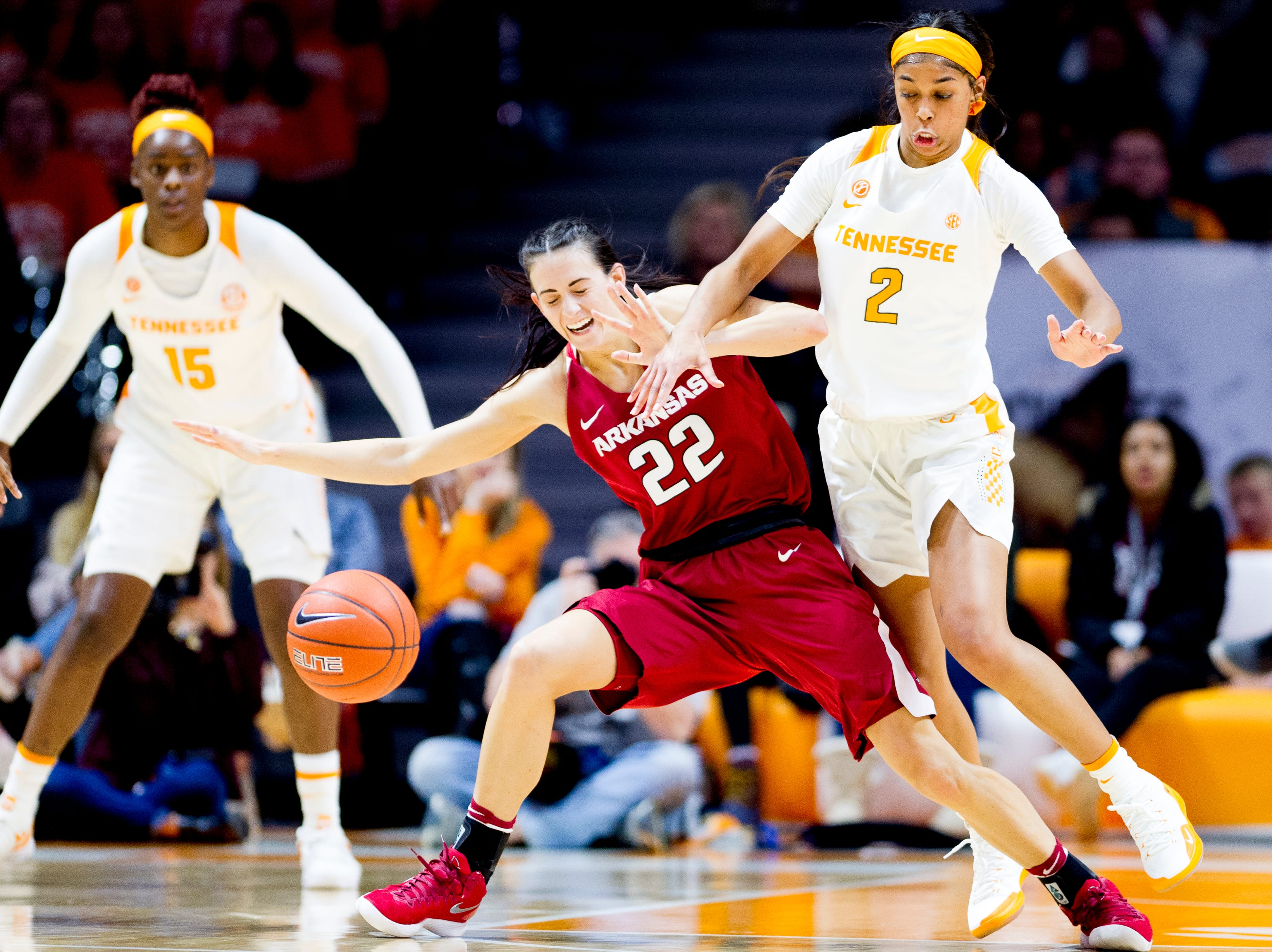 Arkansas guard/forward Bailey Zimmerman (22) loses control of the ball while defended against by Tennessee guard Evina Westbrook (2) during a game between Tennessee and Arkansas at Thompson-Boling Arena in Knoxville, Tennessee on Monday, January 21, 2019.