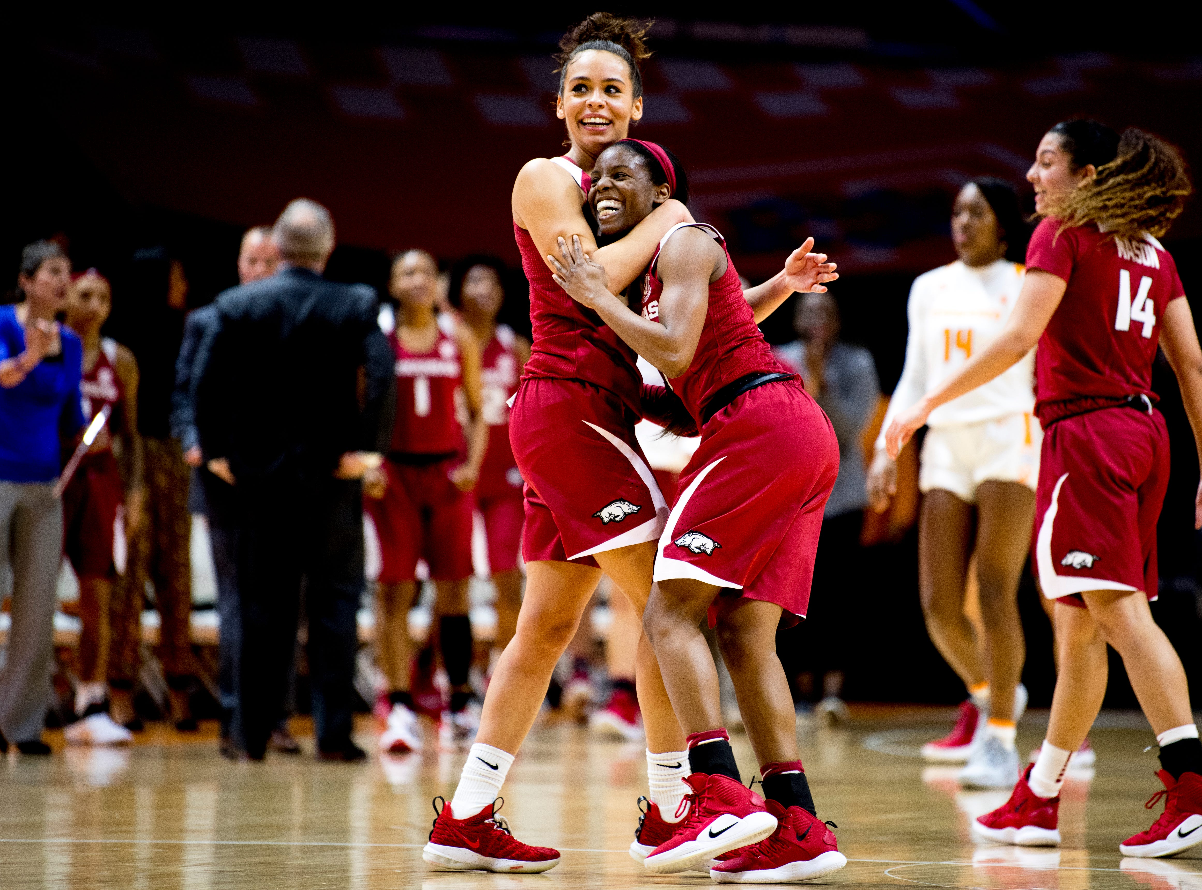 Arkansas guard Chelsea Dungee (33) celebrates with Arkansas guard Malica Monk (3) on her point to put the team ahead during a game against Tennessee at Thompson-Boling Arena in Knoxville, Tennessee on Monday, January 21, 2019.