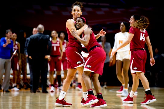 Arkansas' Chelsea Dungee, left, celebrates with teammate Malica Monk after Monk's decisive basket against Tennessee Monday night at Thompson-Boling Arena.