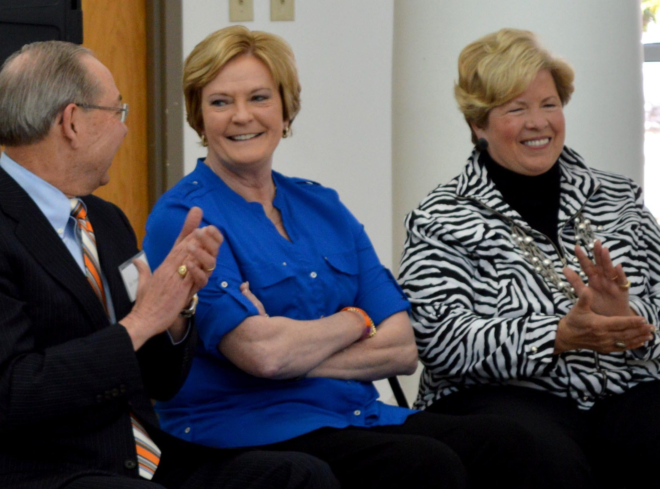UT Women's Basketball Coach Emeritus coach Pat Summitt, center, seated with UT Chancellor Jimmy Cheek, and UT Women's Athletic Director Emeritus Joan Cronan is honored with the dedication of the Tennessee Blue Book on Friday, Feb. 28, 2014.