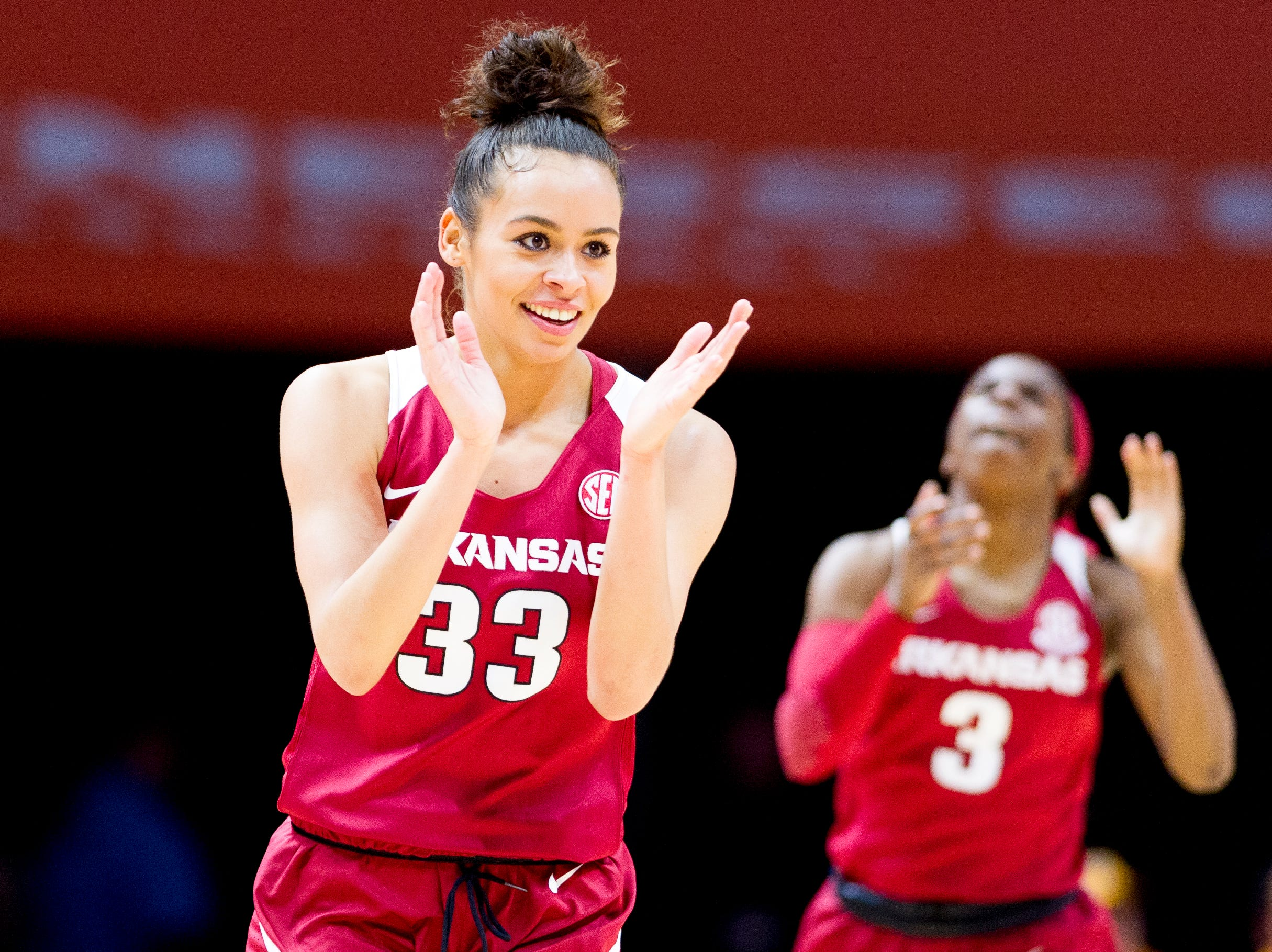Arkansas guard Chelsea Dungee (33) celebrates after making a point as Arkansas guard Malica Monk (3) claps in the background during a game between Tennessee and Arkansas at Thompson-Boling Arena in , Tennessee on Monday, January 21, 2019.