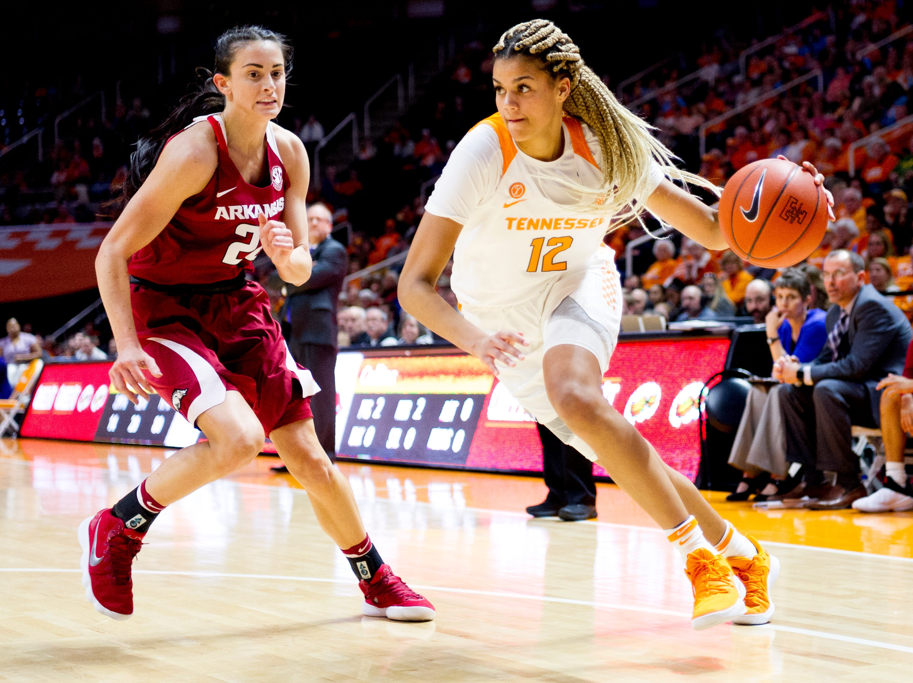Tennessee guard/forward Rae Burrell (12) dribbles around Arkansas guard/forward Bailey Zimmerman (22) during a game between Tennessee and Arkansas at Thompson-Boling Arena in Knoxville, Tennessee on Monday, January 21, 2019.