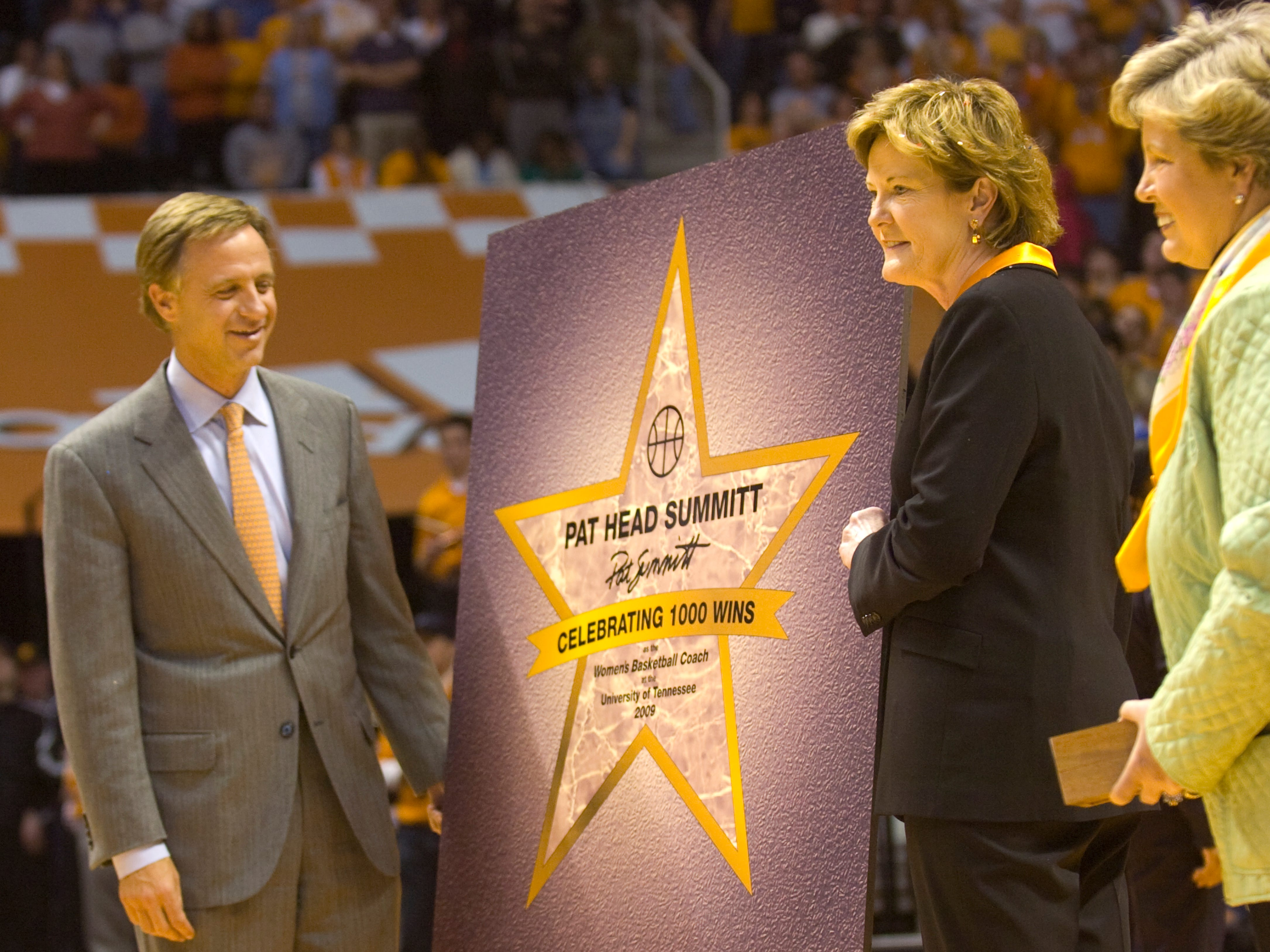 Tennessee head coach Pat Summitt is presented with a star by Knoxville Mayor Bill Haslam,left, after earning her 1000th at Thompson-Boling Arena Wednesday. At right is University of Tennessee women's athletics director Joan Cronan.