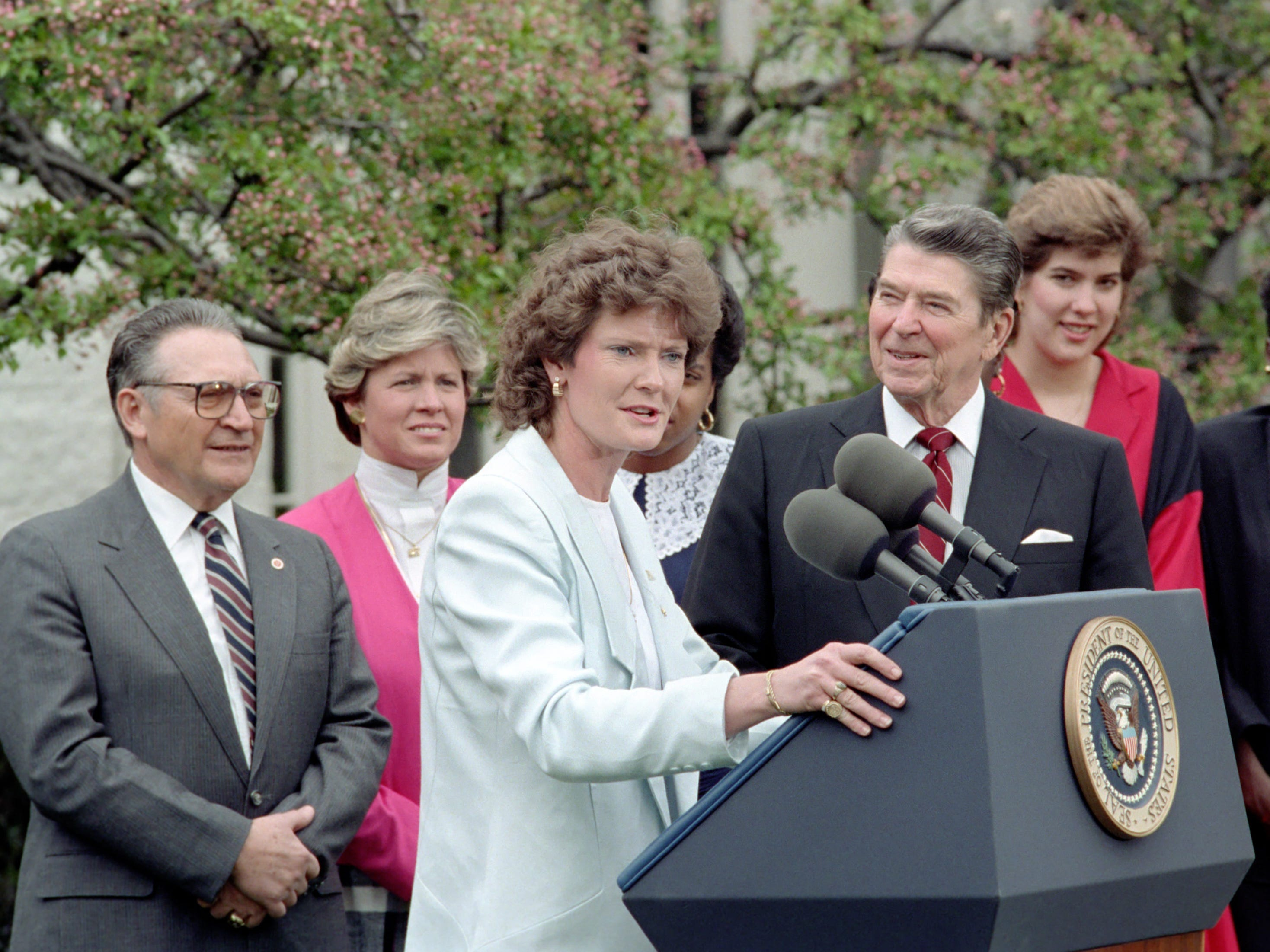 Coach Pat Summitt speaks as President Ronald Reagan hosts the NCAA champion Lady Vols at the White House on April 2, 1987.  Looking on are, from left, UT President Ed Boling, women's athletic director Joan Cronan, Lady Vol Sheila Frost and Lady Vol Melissa McCray.