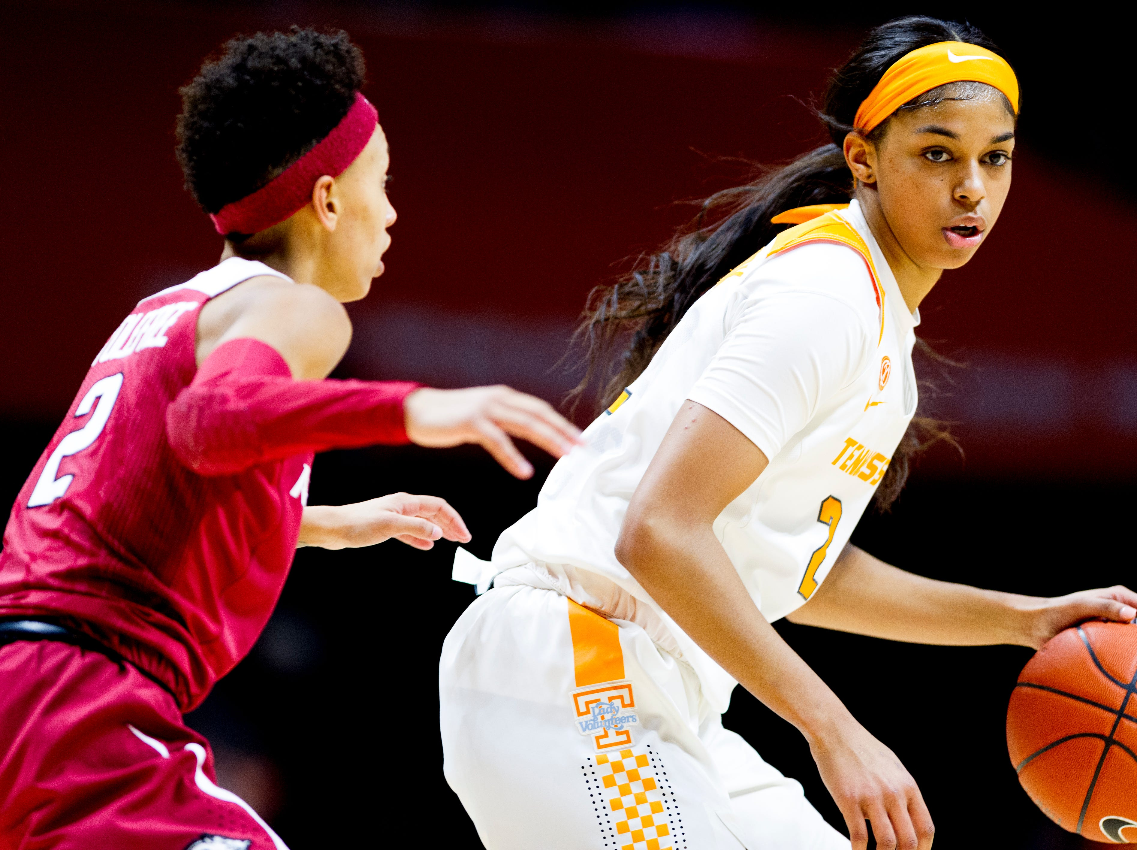 Tennessee guard Evina Westbrook (2) looks to dribble down the court as Arkansas guard Alexis Tolefree (2) defends during a game between Tennessee and Arkansas at Thompson-Boling Arena in , Tennessee on Monday, January 21, 2019.