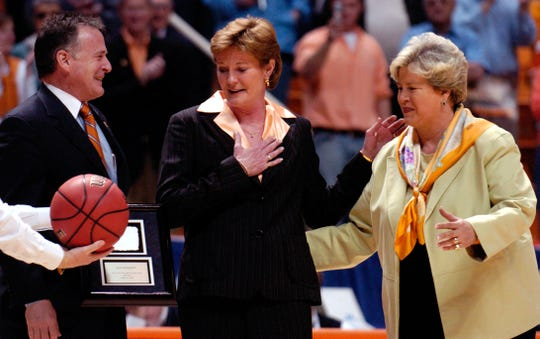 Lady Vol coach Pat Summitt, center, with University President John Petersen and Joan Cronan as she was recognized for her 880th win.
