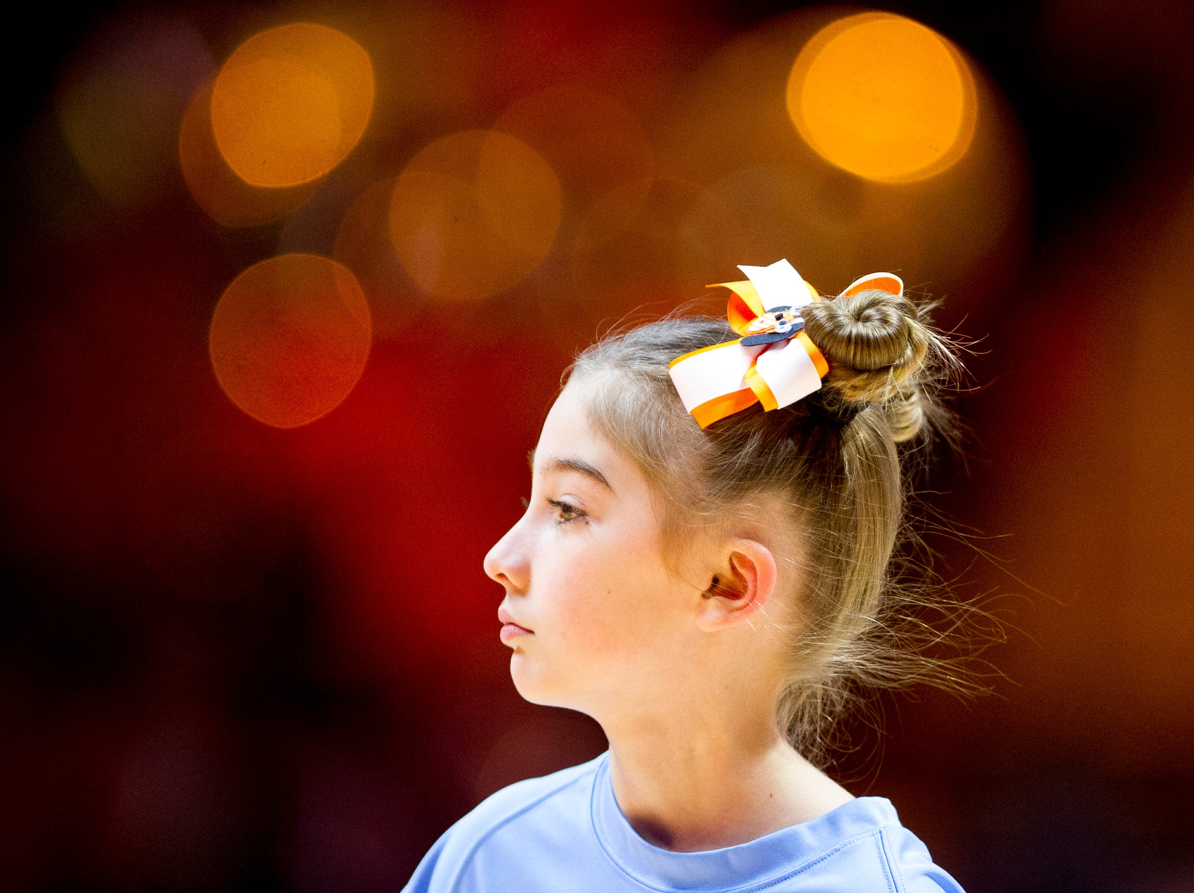 A young team member cleans the floors during a game between Tennessee and Arkansas at Thompson-Boling Arena in , Tennessee on Monday, January 21, 2019.