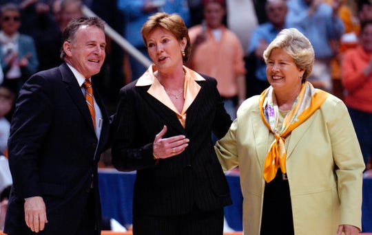Joan Cronan (right) stands with Tennessee Lady Vols coach Pat Summitt and university president John Petersen as Summitt was recognized for her 880th win.