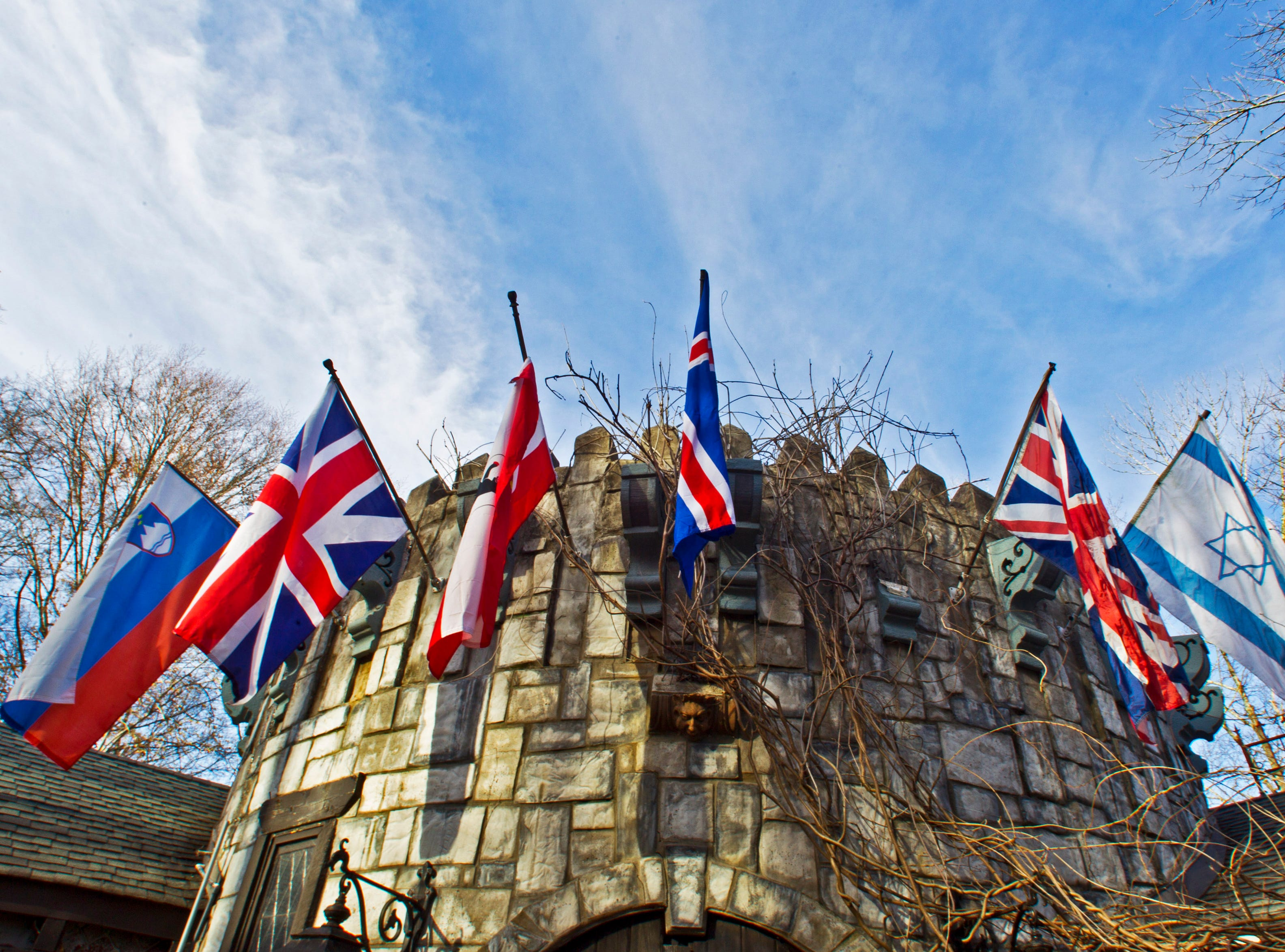 Flags of various countries hang above the entrance at Williamswood Castle is shown Sunday, March 15, 2015, in Knoxville, Tenn.