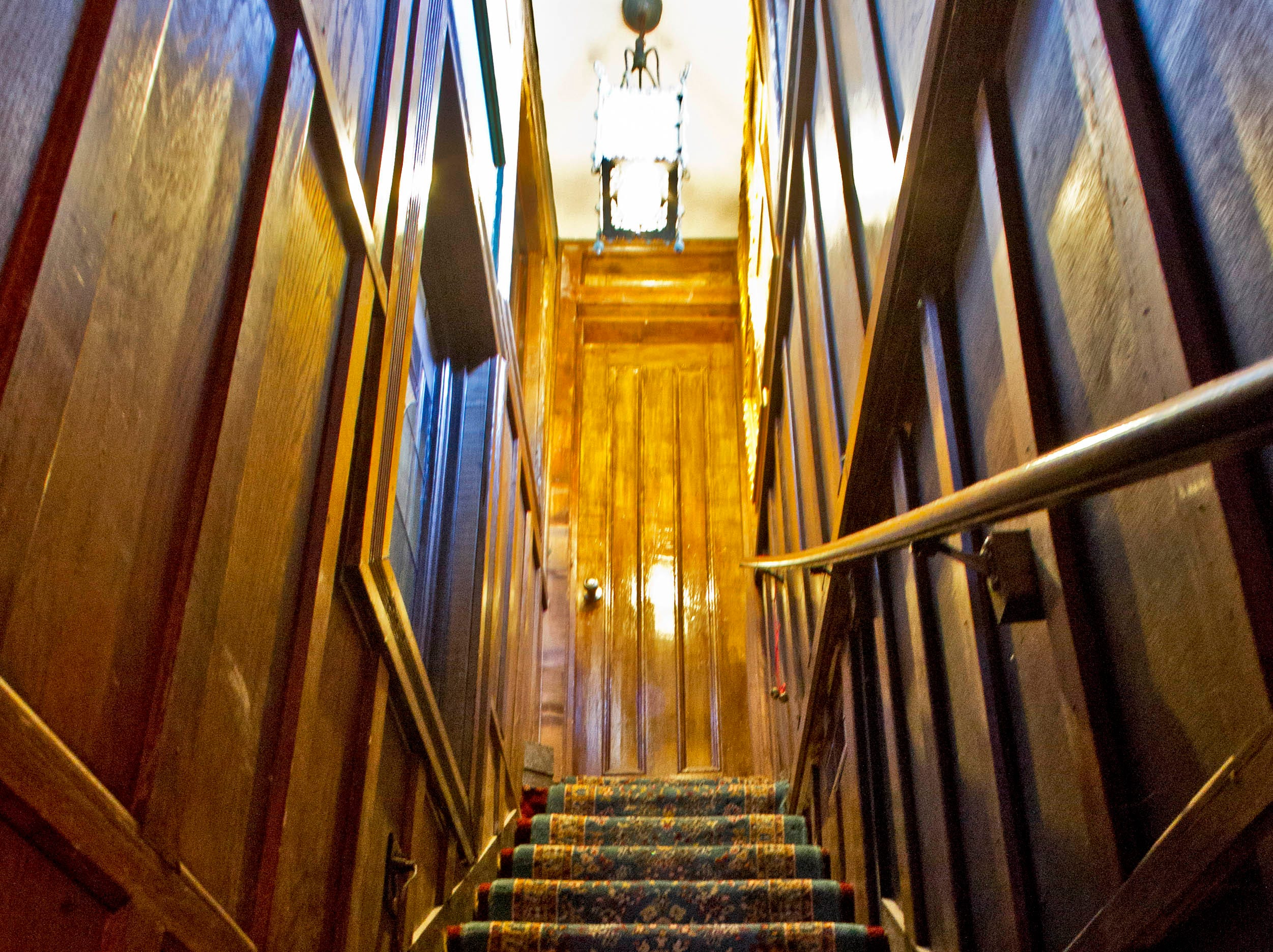 A narrow stairway leads to a bedroom at Williamswood Castle Sunday, March 15, 2015, in Knoxville, Tenn.