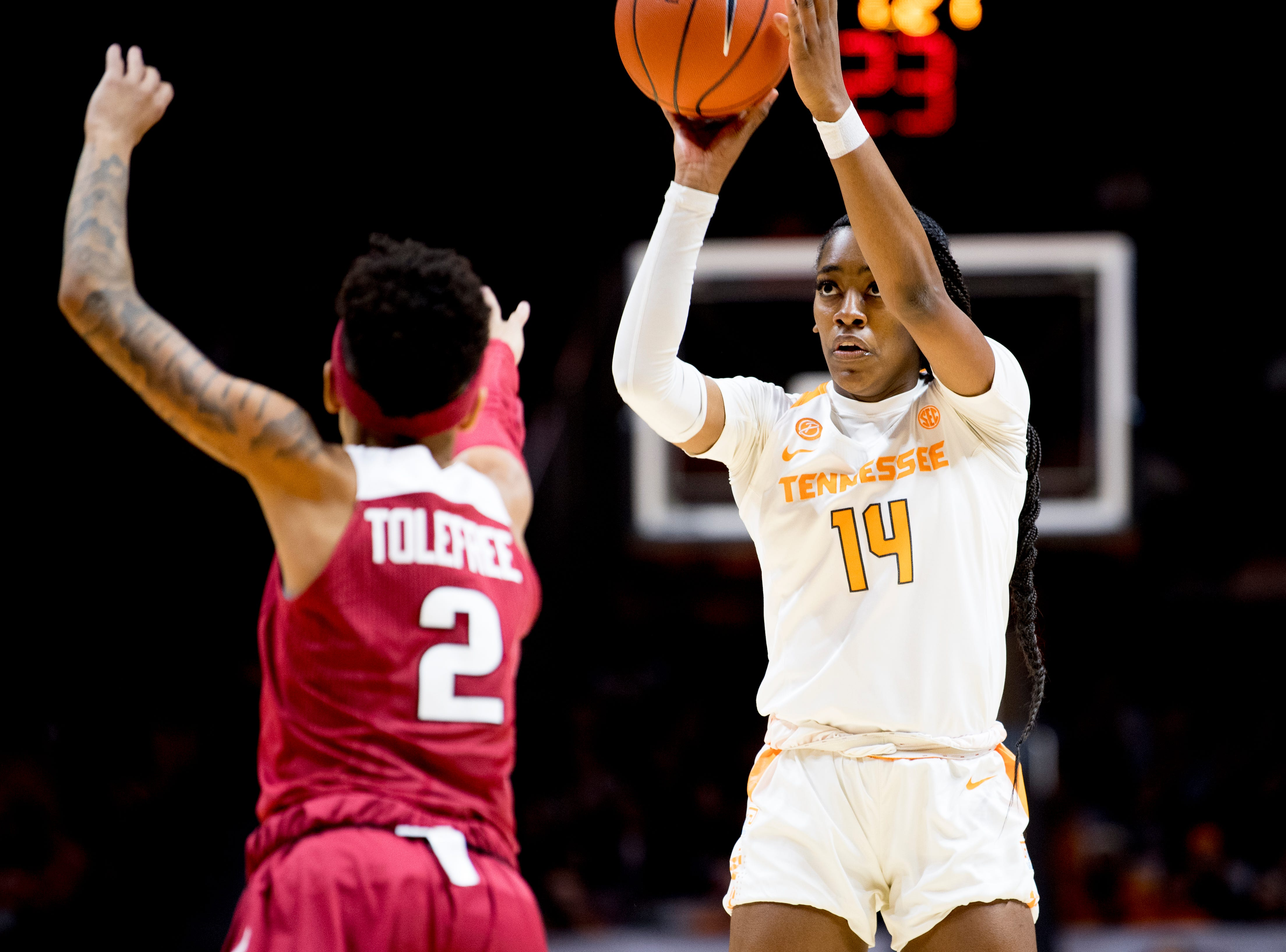 Tennessee guard Zaay Green (14) shoots the ball past Arkansas guard Alexis Tolefree (2) during a game between Tennessee and Arkansas at Thompson-Boling Arena in , Tennessee on Monday, January 21, 2019.
