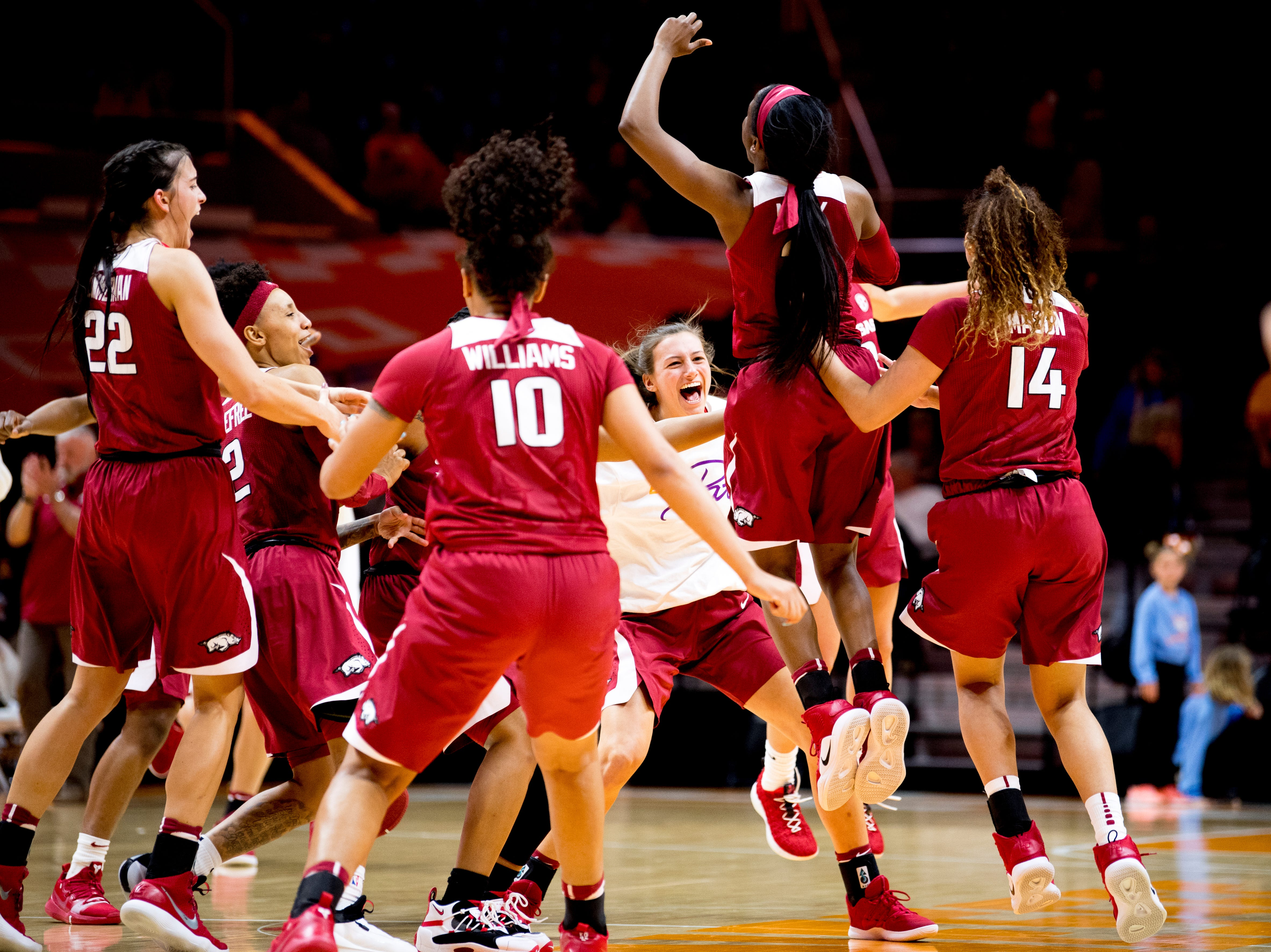 Arkansas celebrates their 80-79 win over Tennessee at Thompson-Boling Arena in Knoxville, Tennessee on Monday, January 21, 2019.