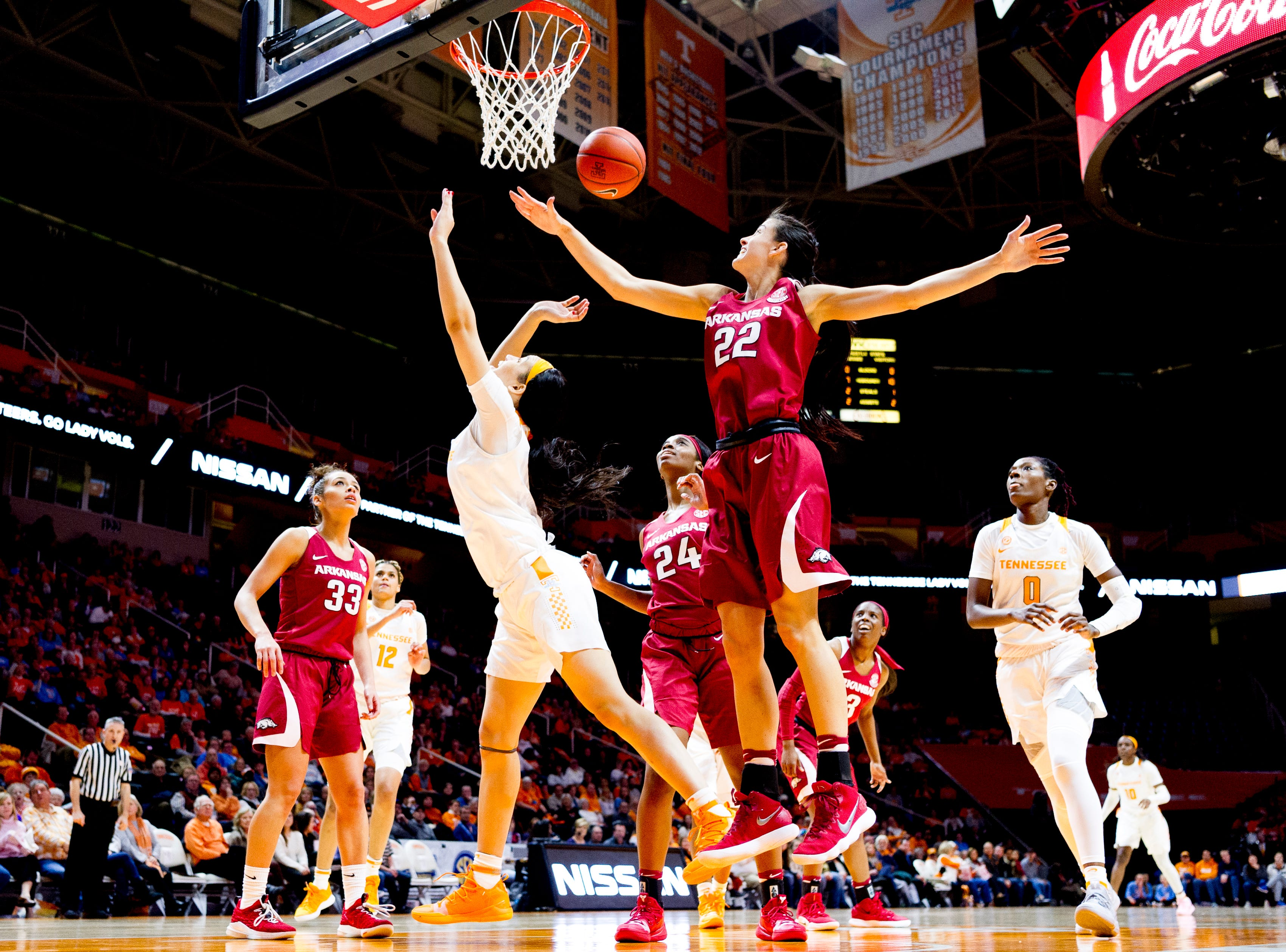 Tennessee forward Mimi Collins (4) tries to shoot a ball as Arkansas guard/forward Bailey Zimmerman (22) defends during a game between Tennessee and Arkansas at Thompson-Boling Arena in , Tennessee on Monday, January 21, 2019.