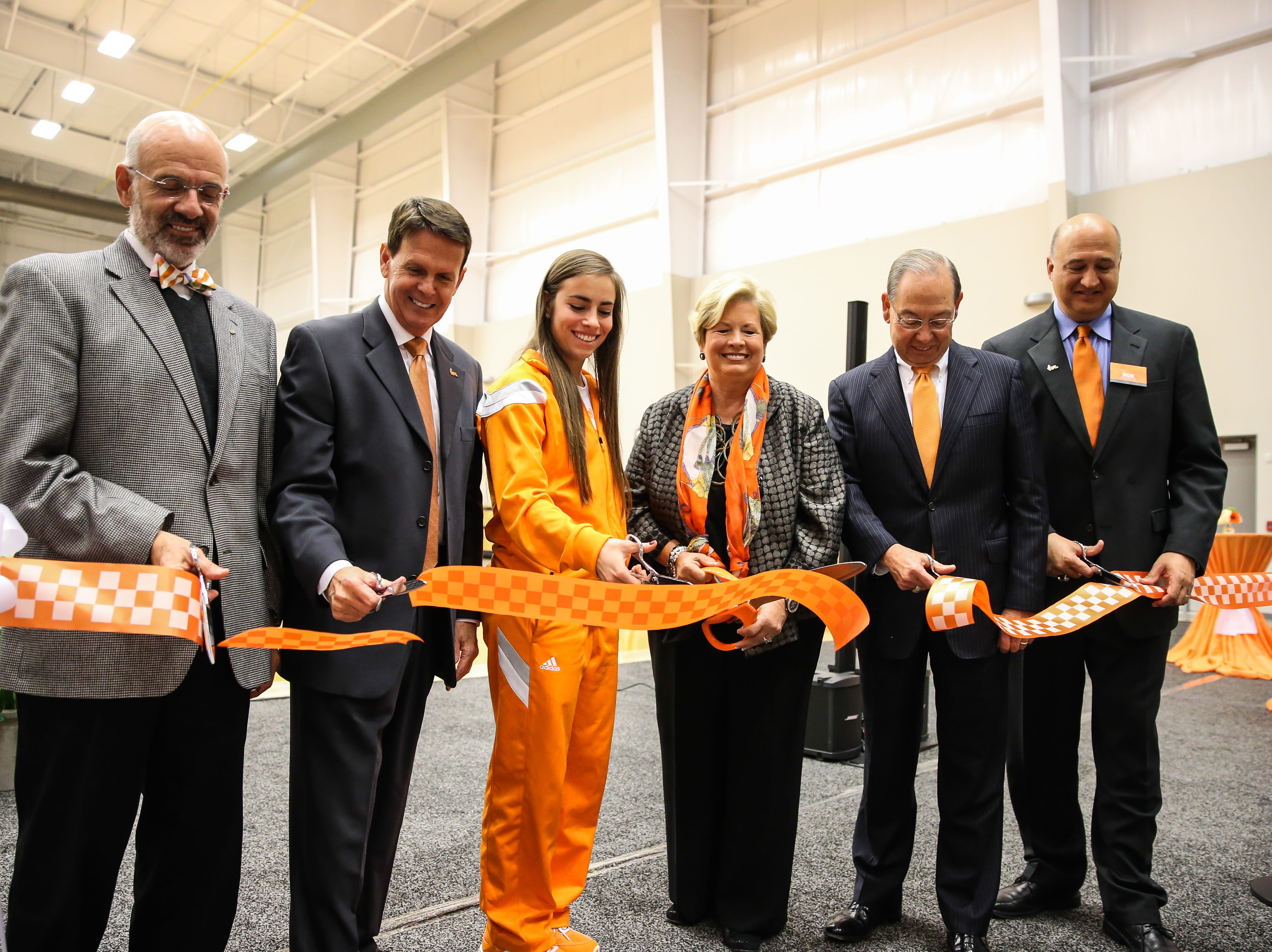 From left, Tennessee president Dr. Joe DiPietro, athletic director Dave Hart, volleyball captain Megan Hatcher, former womenÕs AD Joan Cronan, chancellor Jimmy Cheek and Lady Vols coach Rob Patrick do the official ribbon cutting for the Joan Cronan Volleyball Center on Friday.