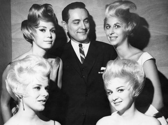 Joseph Weir, then the president of the National Hairdressers and Cosmetologists Association, poses with four women whose hair his team styled in 1962.