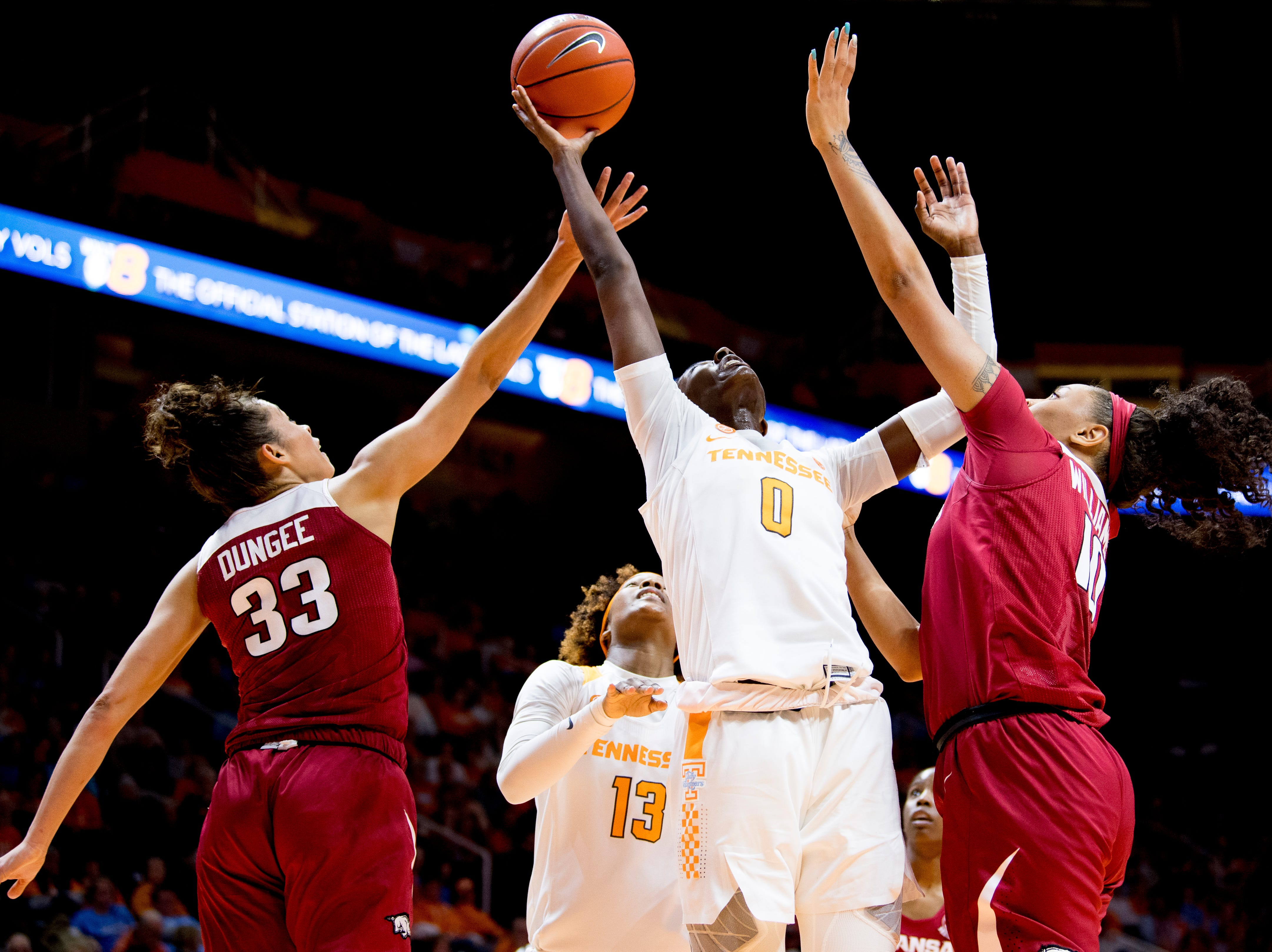 Tennessee guard/forward Rennia Davis (0) shoots a layup past the defense during a game between Tennessee and Arkansas at Thompson-Boling Arena in , Tennessee on Monday, January 21, 2019.