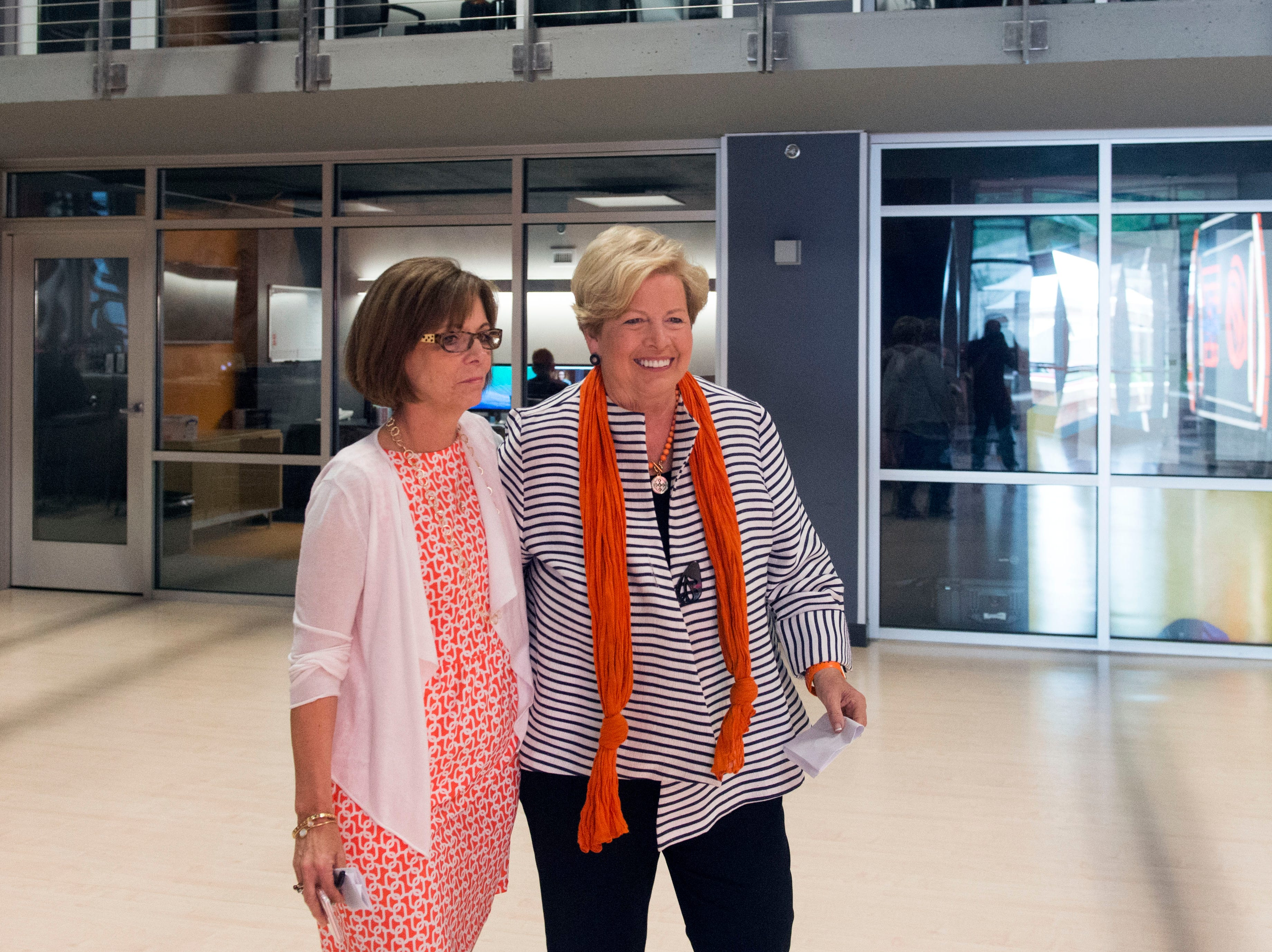 Margie Nichols, University of Tennessee Vice Chancellor of Communications, escorts Joan Cronan, former athletic director for the Lady Vols, to a news conference on Tuesday, June 28, 2016 to share her thoughts on Pat Summitt.
