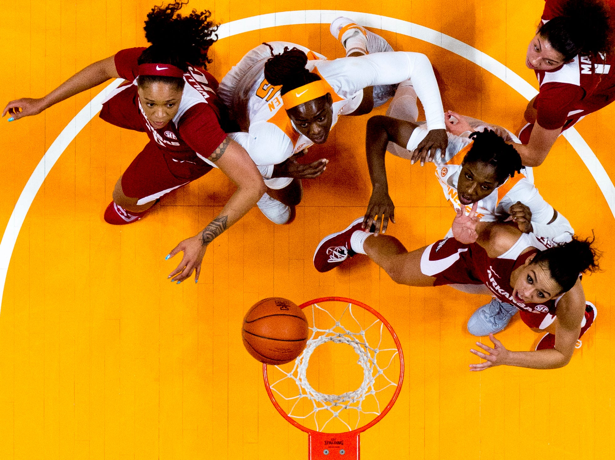 Players eye the ball above the rim during a game between Tennessee and Arkansas at Thompson-Boling Arena in Knoxville, Tennessee on Monday, January 21, 2019.