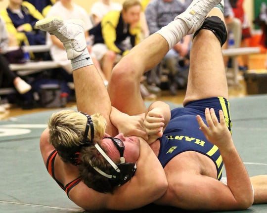 Brighton's Luke Stanton (left) has won all 10 of his matches this season with pins.