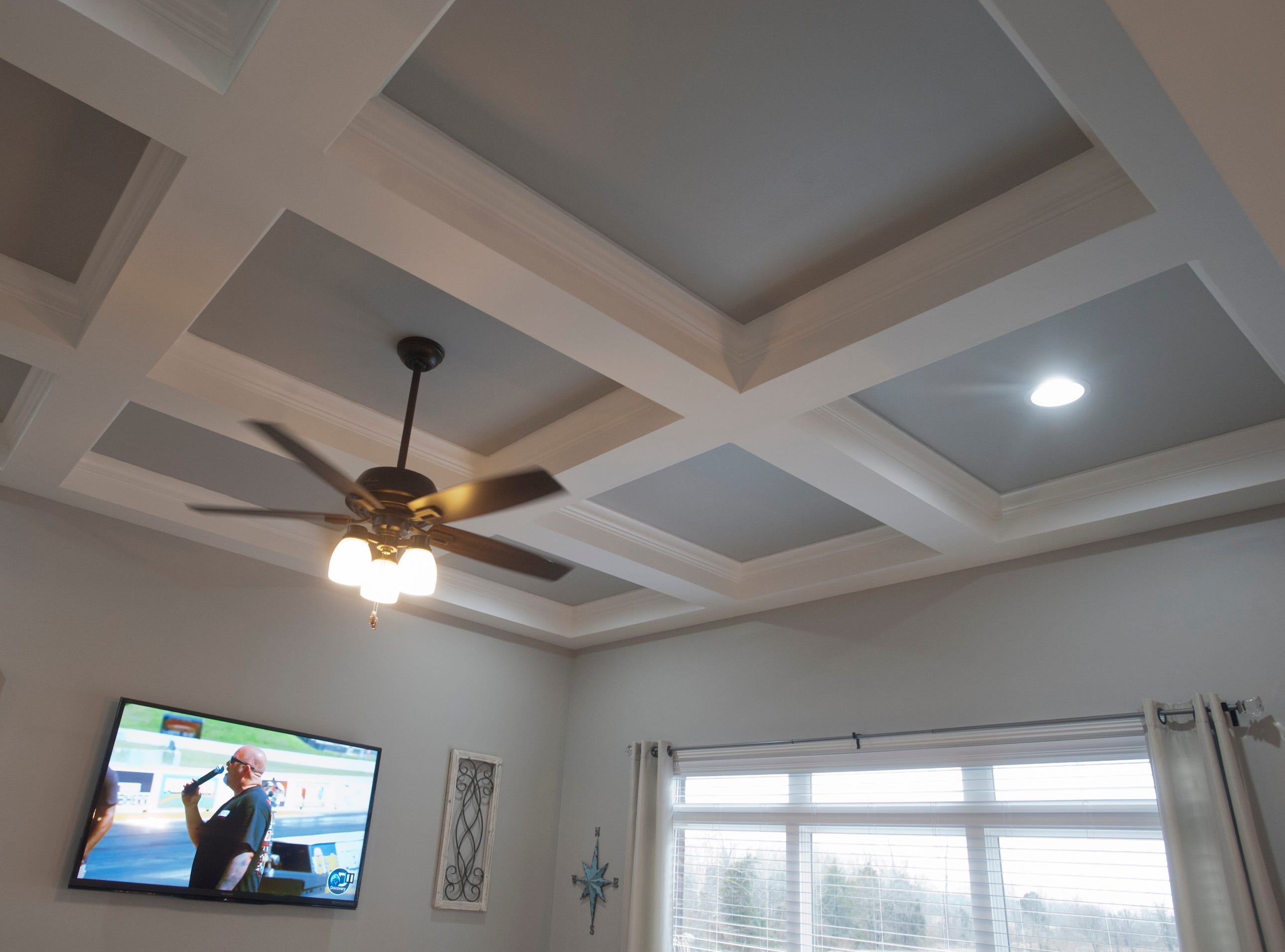 The 10-feet-high coffered ceiling in the first floor family room.