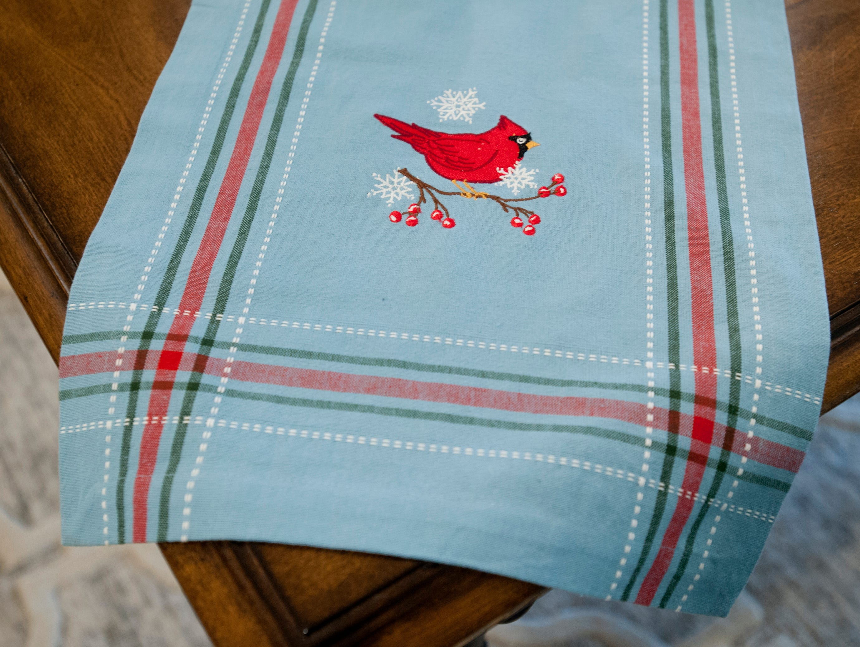 Detail of a Cardinal runner on the basement kitchen table.