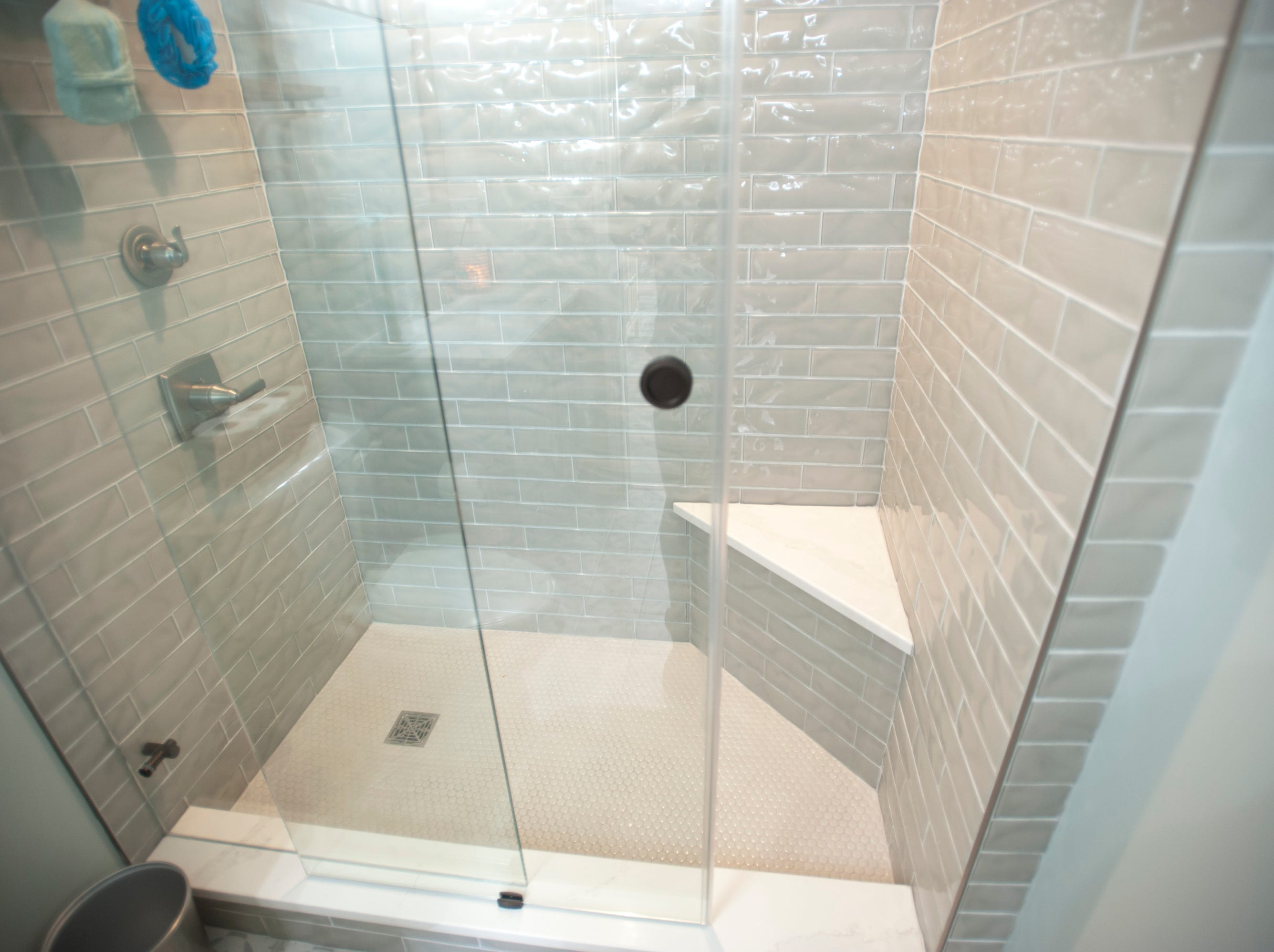 The basement shower uses a barn-door-style sliding glass.