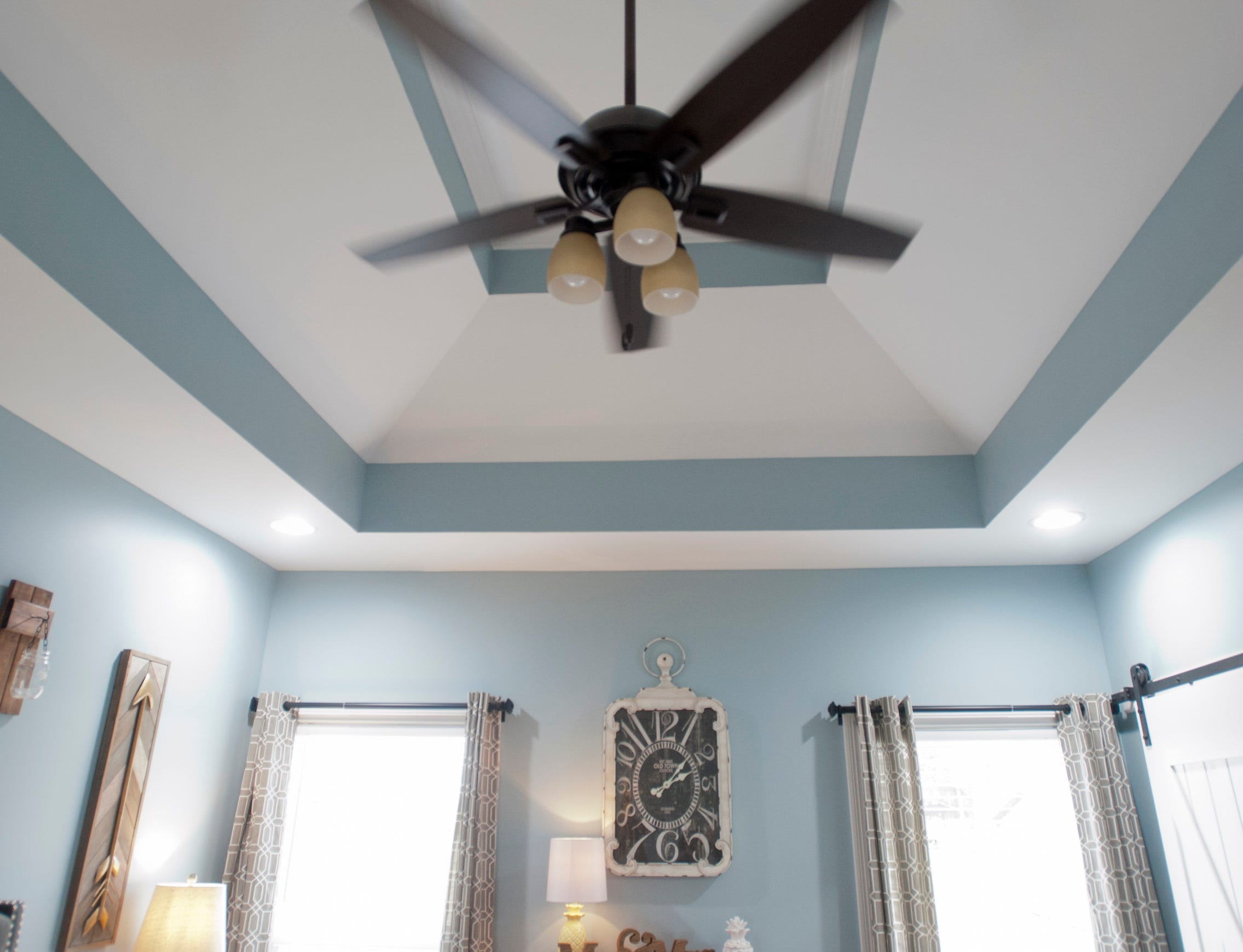 The 10-foot-high master bedroom double-tray ceiling.