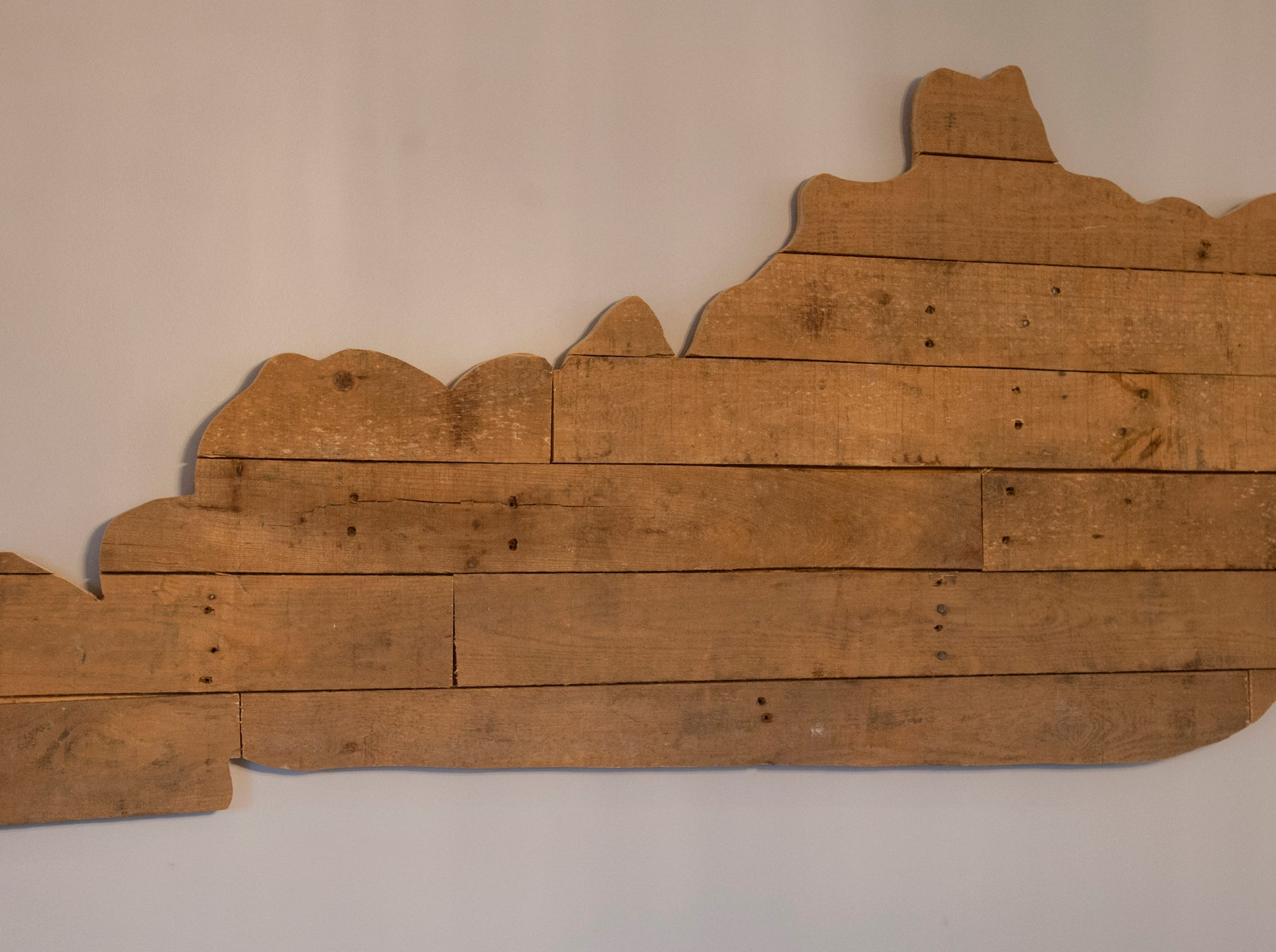 A wood board state of Kentucky adorns the eating area wall.