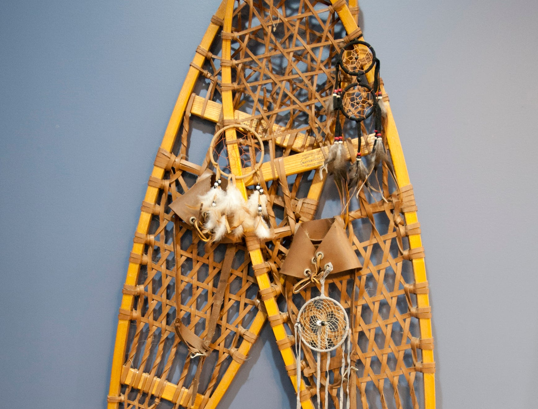 "Snow shoes decorate a wall of the Bell's son, Hunter's room in keeping with a ""hunter"" theme.