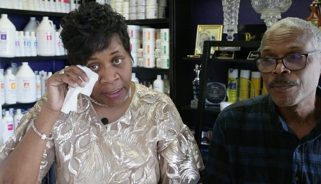 Tami Charles reacts as she talks about the suicide of her son, Seven, who died over the weekend. Her husband, Donnie Bridges, is at right.