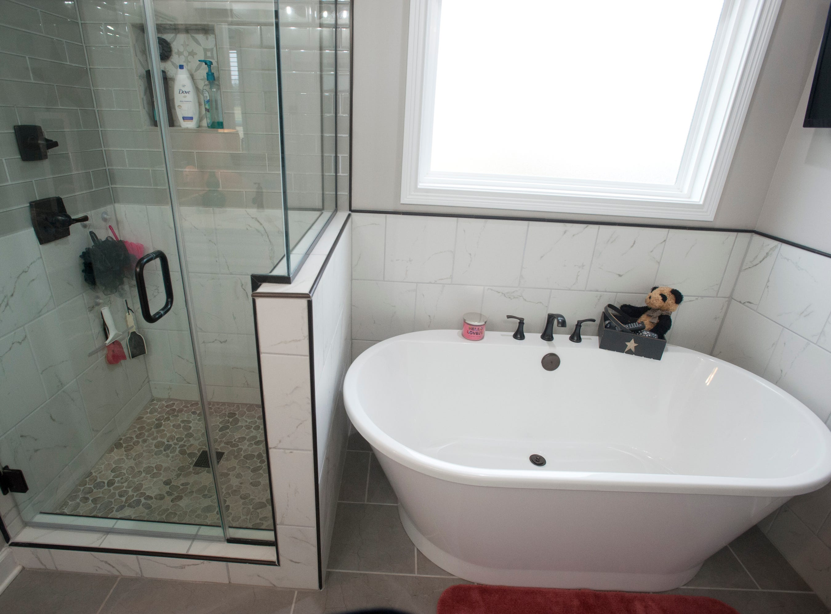 The master bathroom walk-in shower and soaking tub.