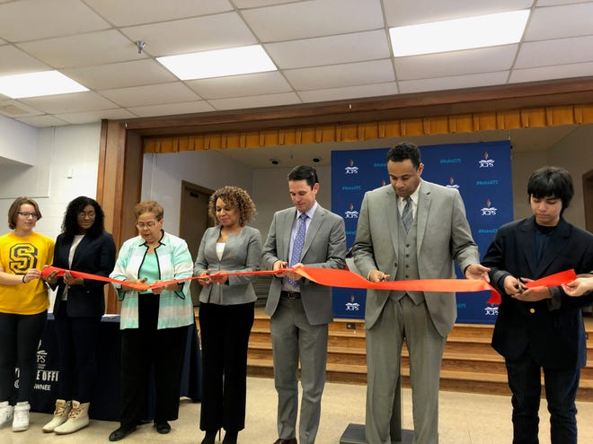 JCPS Superintendent Marty Pollio, third from right, cuts a ribbon opening the district's new satellite office in Shawnee on Jan. 22, 2019.