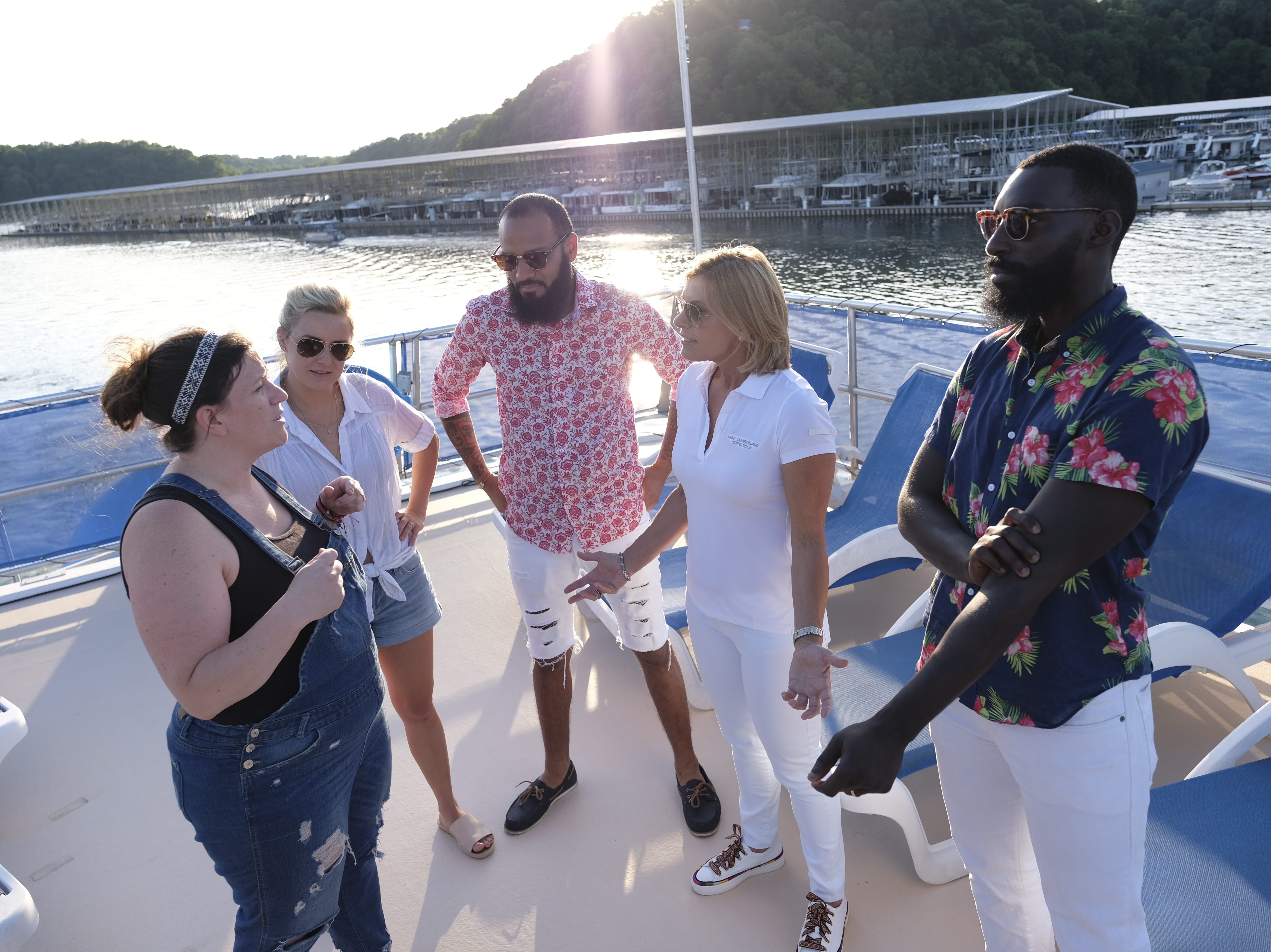 (from left): Contestant Sara Bradley, Kelsey Barnard, Justin Sutherland and Eric Adjepong brainstorm with Captain Sandy from 'Below Deck' on episode 8 of Bravo's 'Top Chef: Kentucky' season.